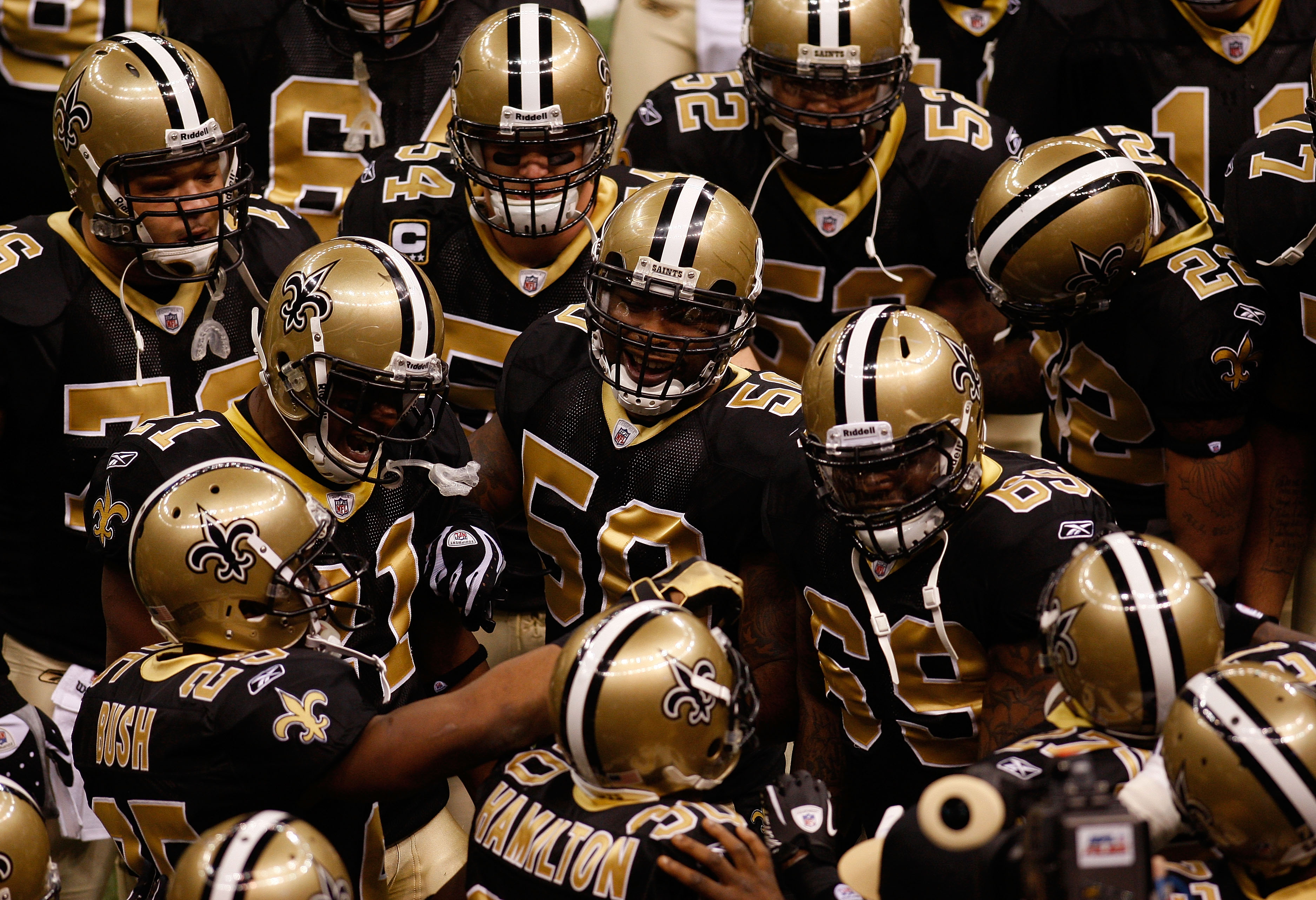 NEW ORLEANS - JANUARY 16:  Players from the New Orleans Saints huddle up on the field during warm ups against the Arizona Cardinals during the NFC Divisional Playoff Game at Louisana Superdome on January 16, 2010 in New Orleans, Louisiana.  (Photo by Chri