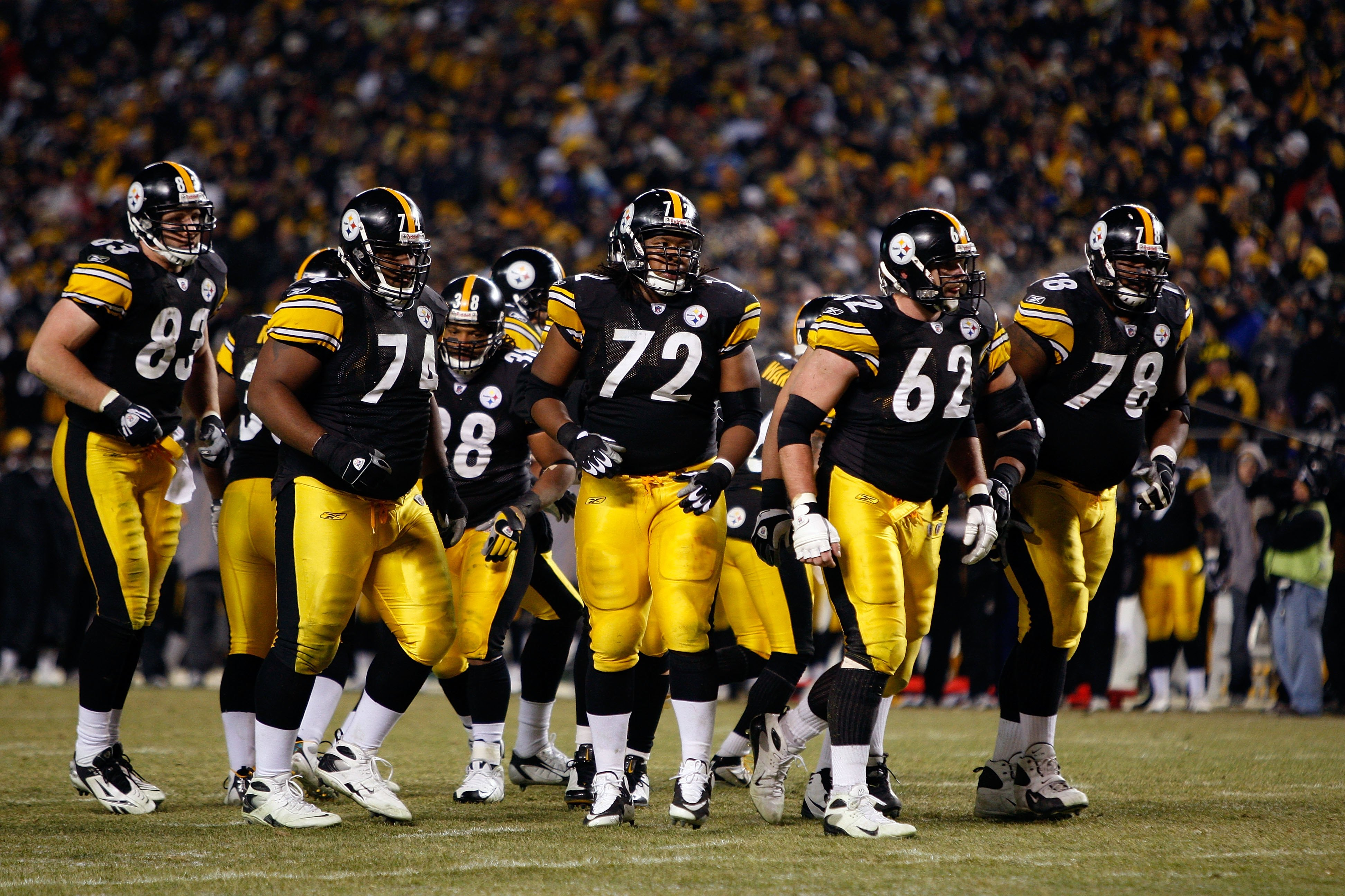 PITTSBURGH - JANUARY 11:  (L-R) Heath Miller #83, Willie Colon #74, Carey Davis, #38, Darnell Stapleton #72, Justin Hartwig #62 and Max Starks #78 of the Pittsburgh Steelers break the offensive huddle against the San Diego Chargers during their AFC Divisi