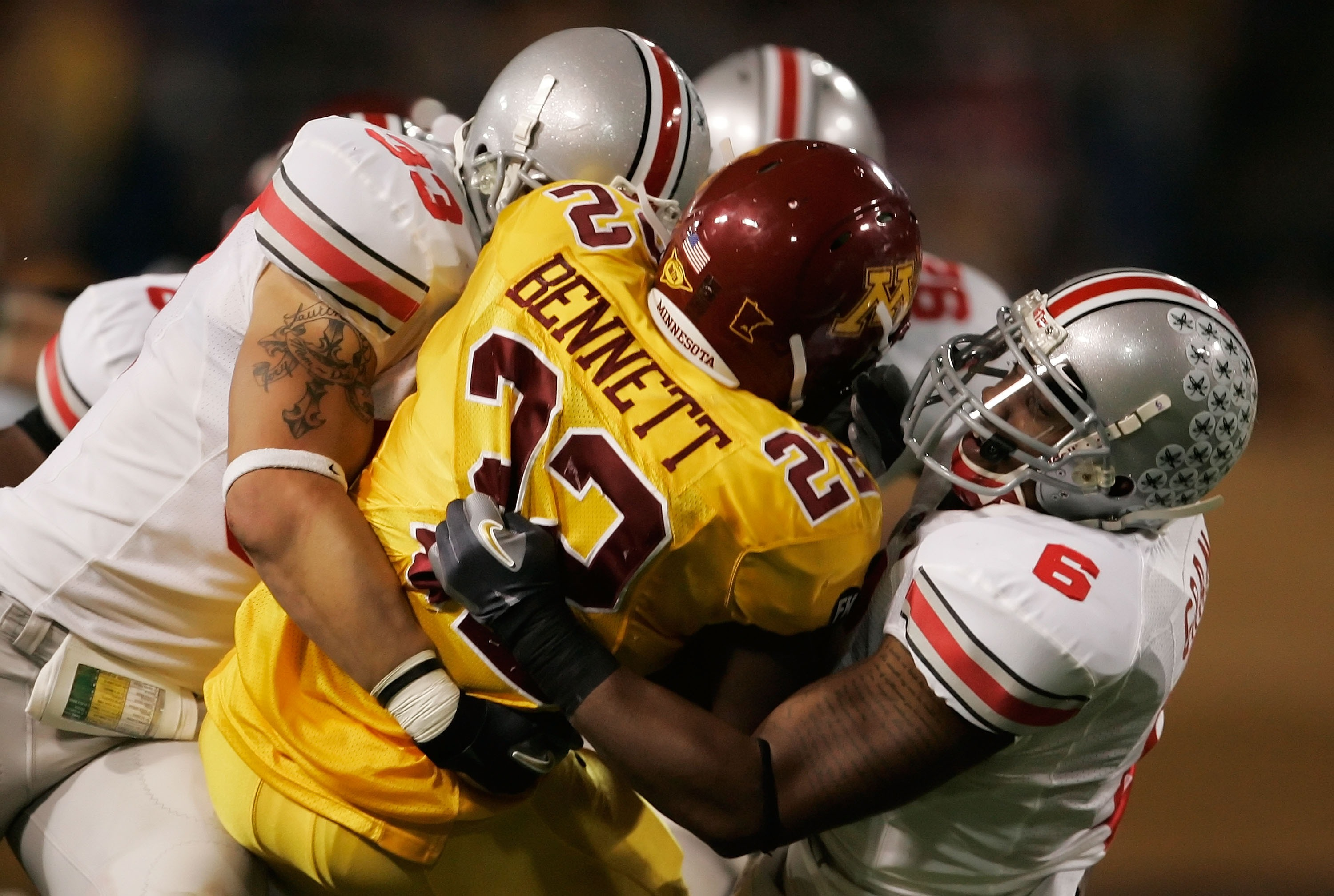 MINNEAPOLIS, MN - SEPTEMBER 29:  Larry Grant #6 and James Laurinaitis #33 of the Ohio State Buckeyes team up to tackle Duane Bennett #22 of the Minnesota Golden Gophers in the third quarter at the Metrodome on September 29, 2007 in Minneapolis, Minnesota.