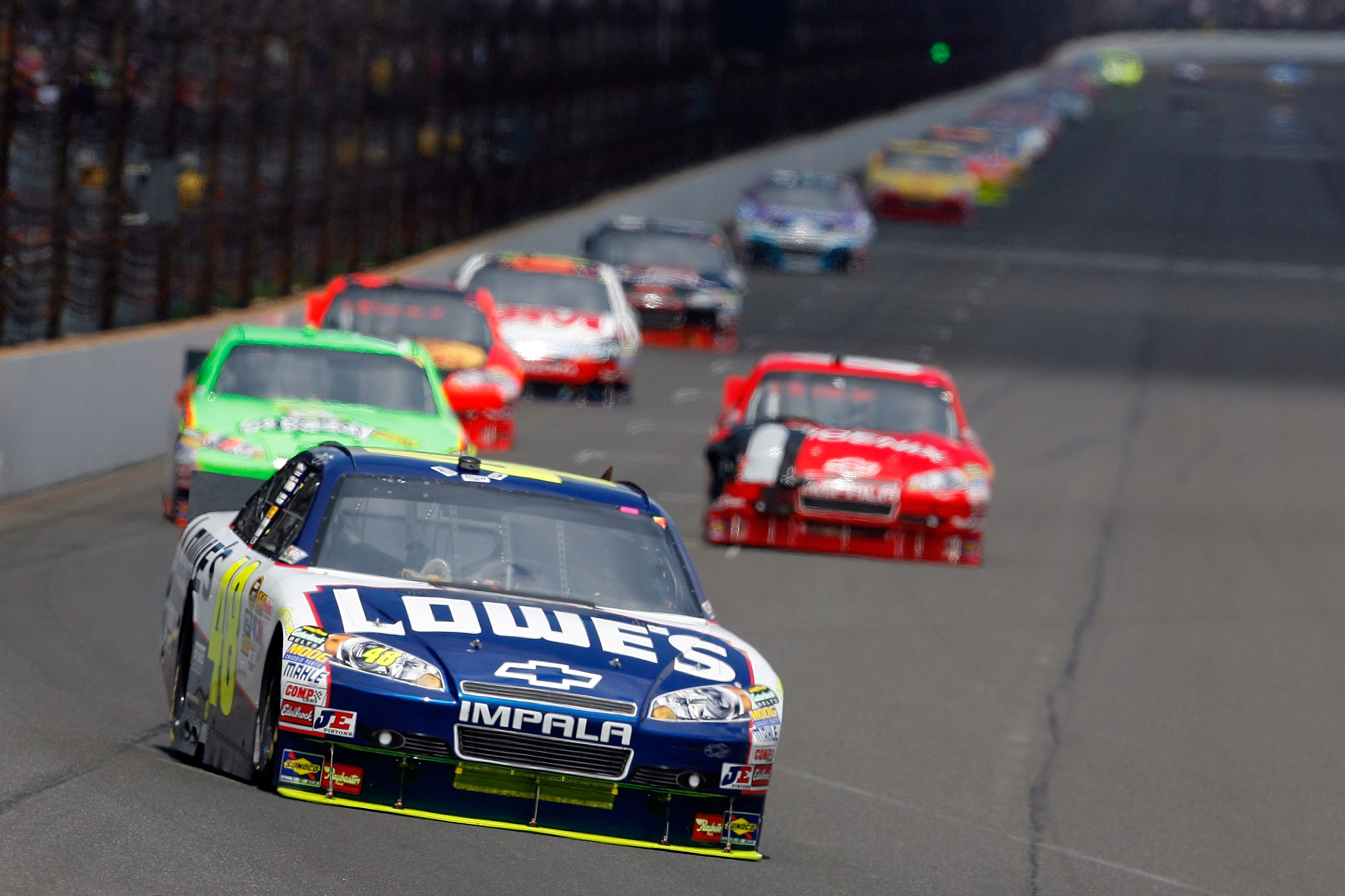 INDIANAPOLIS - JULY 25:  Jimmie Johnson, driver of the #48 Lowe's Chevrolet, leads a pack of cars during the NASCAR Sprint Cup Series Brickyard 400 at Indianapolis Motor Speedway on July 25, 2010 in Indianapolis, Indiana.  (Photo by Tom Pennington/Getty I