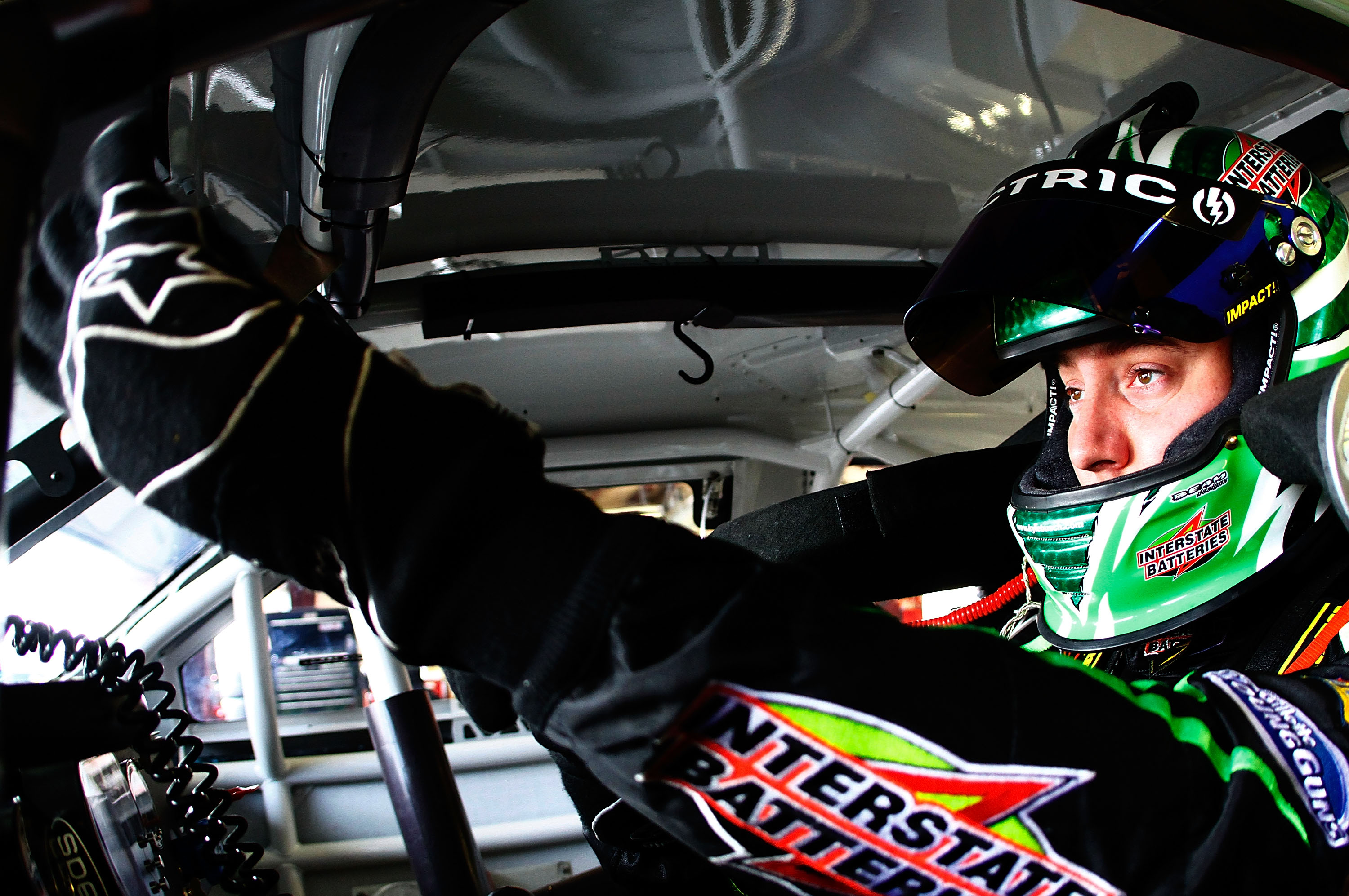 BROOKLYN, MI - AUGUST 13:  Kyle Busch, driver of the #18 Interstate Batteries Toyota, readies himself in his car during practice for the NASCAR Sprint Cup Series CARFAX 400 at Michigan International Speedway on August 13, 2010 in Brooklyn, Michigan.  (Pho