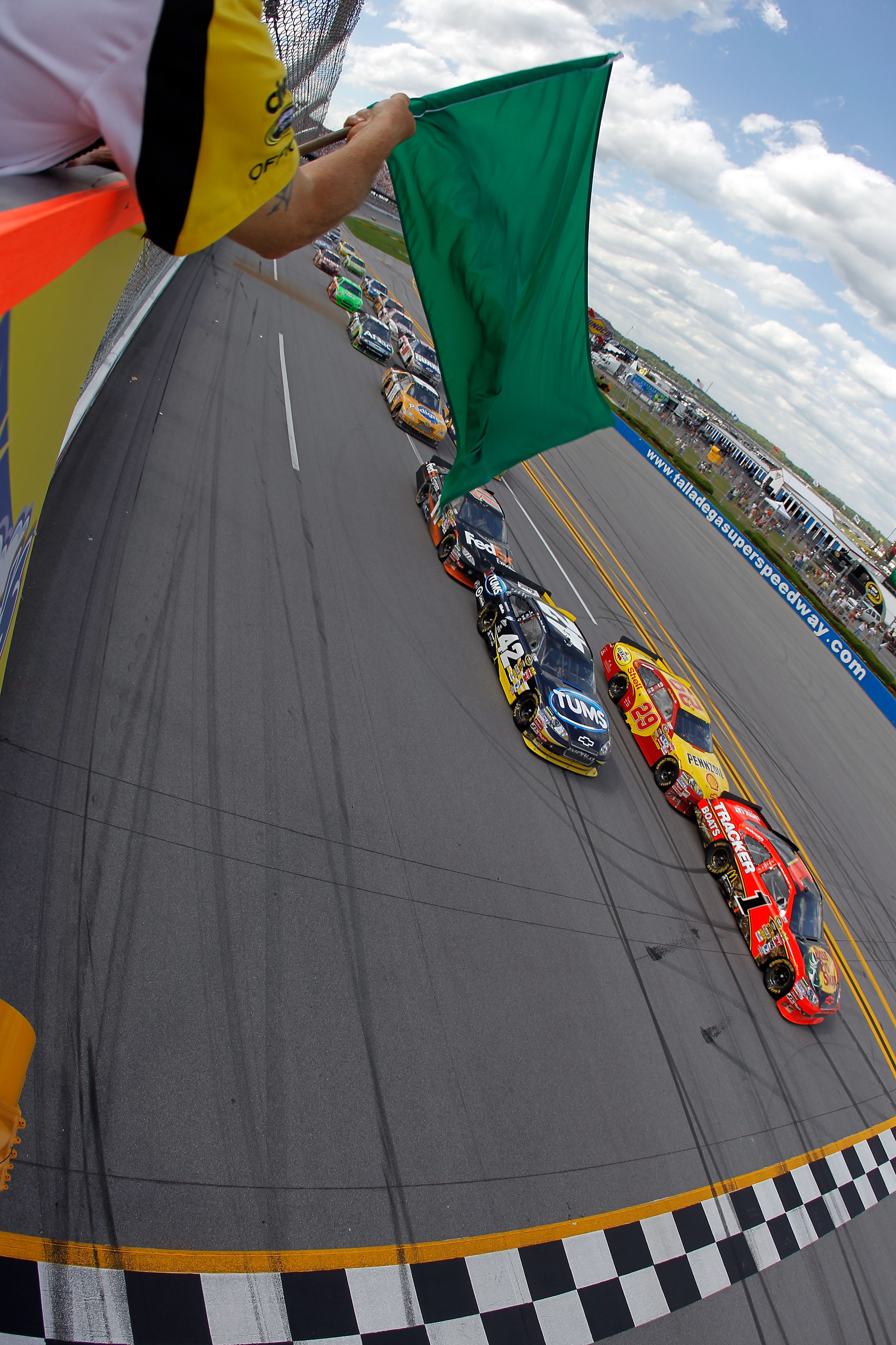 TALLADEGA, AL - APRIL 25:  Jamie McMurray, driver of the #1 Bass Pro Shops/Tracker Boats Chevrolet, leads the field to a restart in the NASCAR Sprint Cup Series Aaron's 499 at Talladega Superspeedway on April 25, 2010 in Talladega, Alabama.  (Photo by Tod