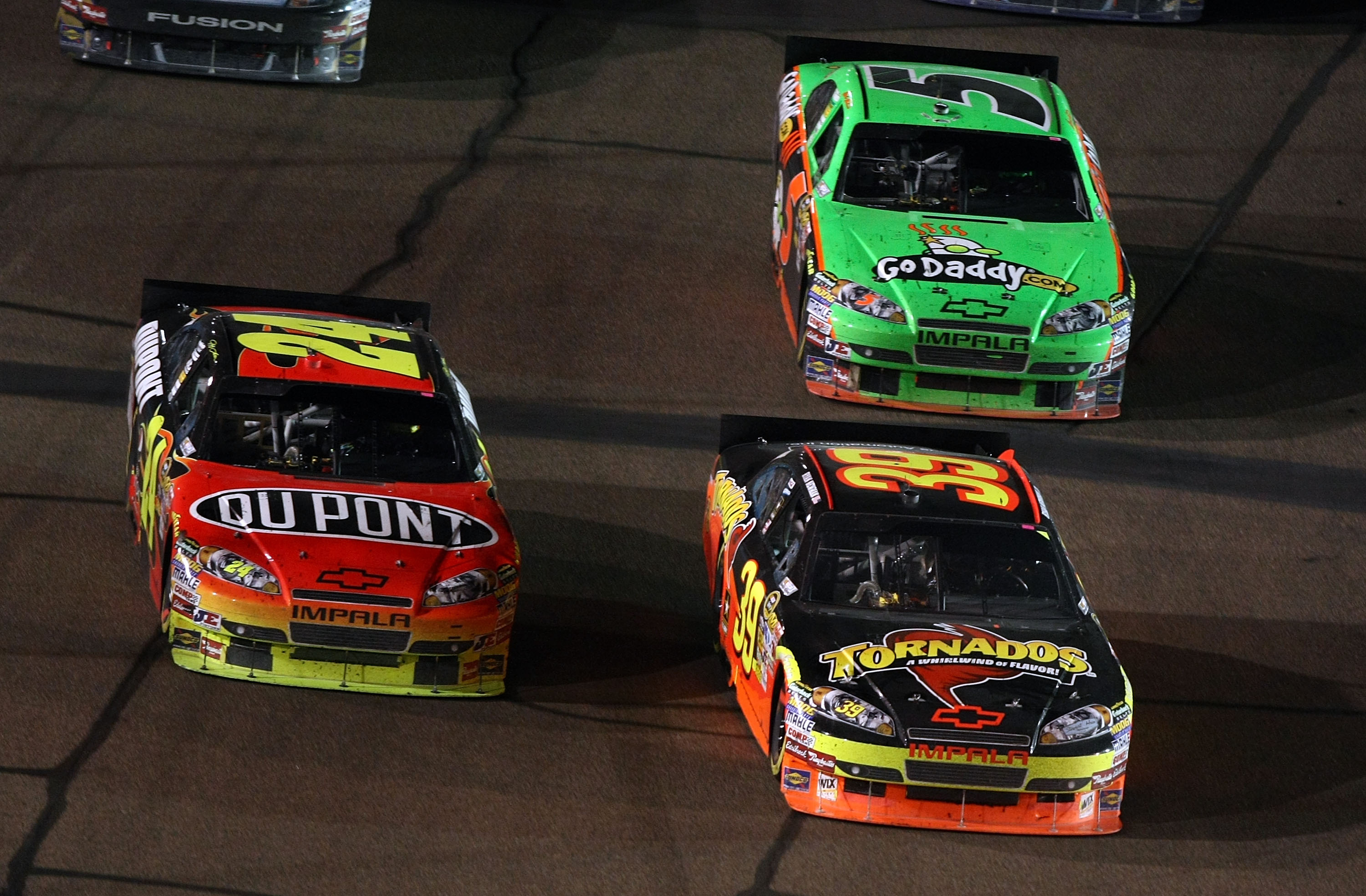 PHOENIX - APRIL 10:  Ryan Newman, driver of the #39 Tornados Chevrolet, drives ahead of Jeff Gordon, driver of the #24 DuPont Chevrolet, on the restart during the NASCAR Sprint Cup Series SUBWAY Fresh Fit 600 at Phoenix International Raceway on April 10,