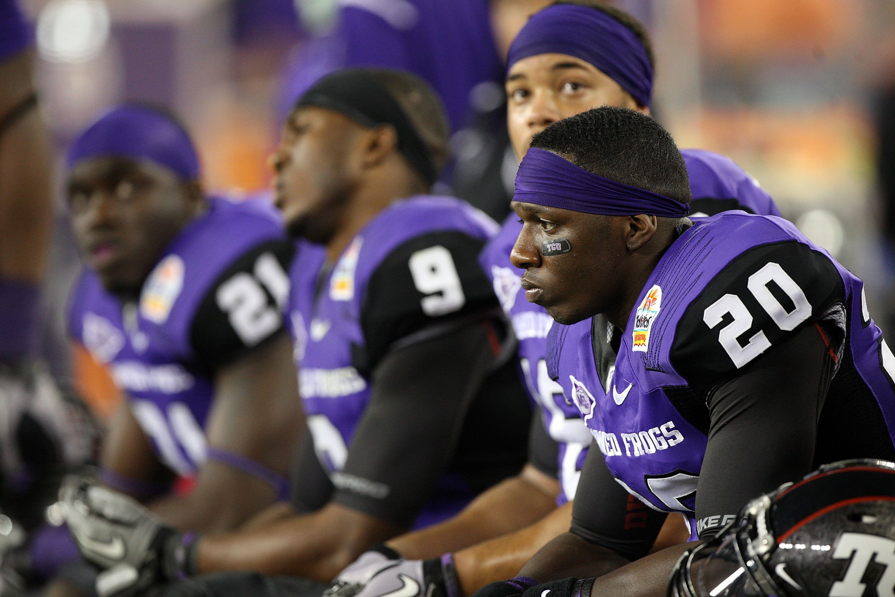 GLENDALE, AZ - JANUARY 04:  Nick Sanders #20 of the TCU Horned Frogs sits on the bench with his teammates against the Boise State Broncos during the Tostitos Fiesta Bowl at the Universtity of Phoenix Stadium on January 4, 2010 in Glendale, Arizona.  (Phot
