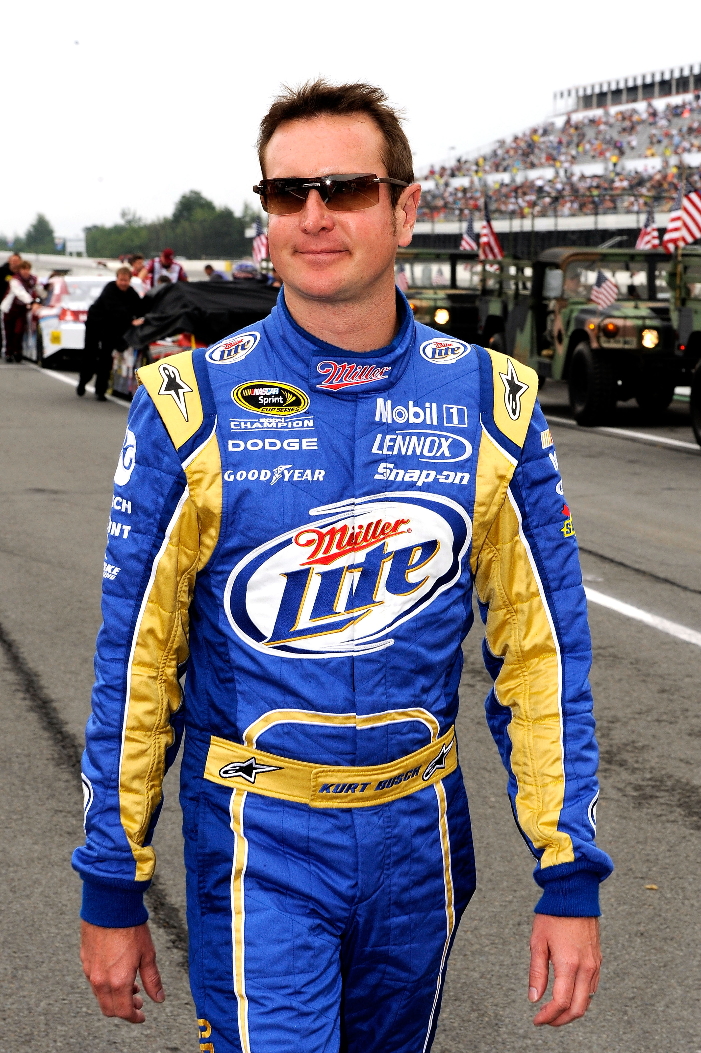 LONG POND, PA - AUGUST 01:  Kurt Busch, driver of the #2 Miller Lite/Vortex Dodge, walks on the grid prior to the NASCAR Sprint Cup Series Sunoco Red Cross Pennsylvania 500 at Pocono Raceway on August 1, 2010 in Long Pond, Pennsylvania.  (Photo by Rusty J