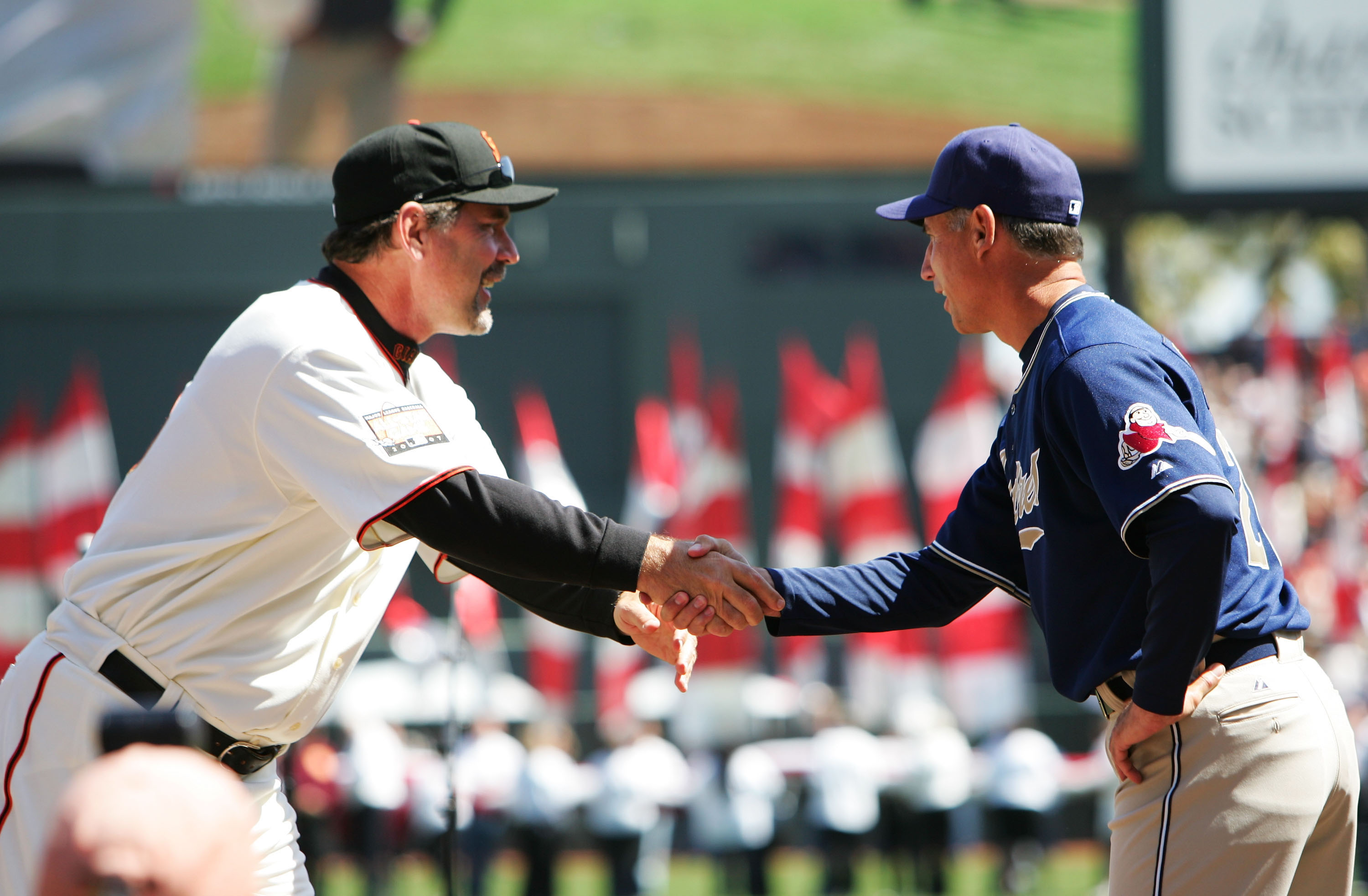SAN FRANCISCO - APRIL 03:  Manager Bruce Bochy of the San Francisco Giants greets Manager Bud Black of the San Diego Padres during pregame ceremonies on the Opening Day of Major League Baseball on April 3, 2007 at AT&T Park in San Francisco, California.