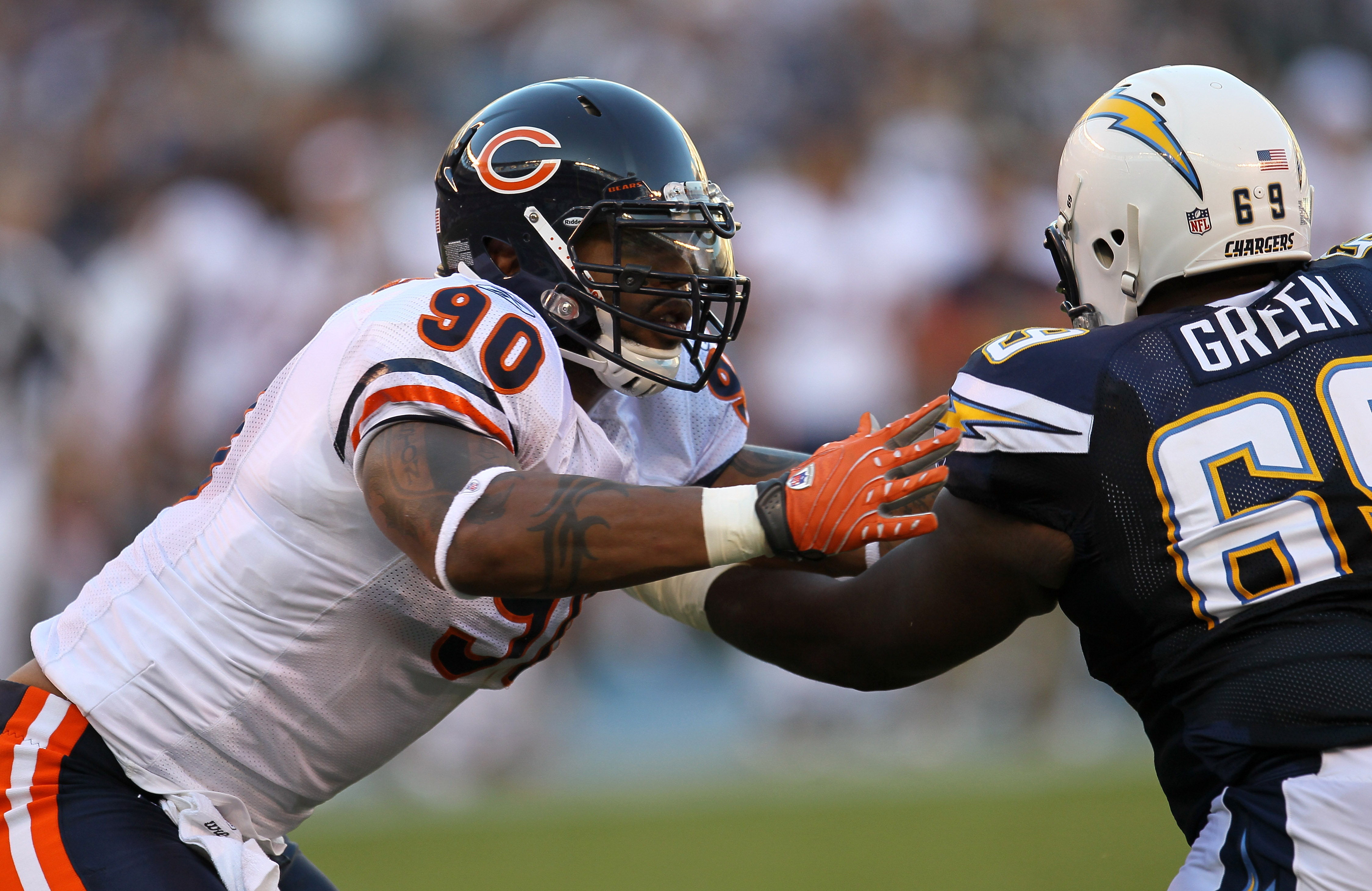 SAN DIEGO - AUGUST 14:  Defensive end Julius Peppers #90 of the Chicago Bears battles offensive guard Tyrondne Green #69 of the San Diego Chargers on August 14, 2010 at Qualcomm Stadium in San Diego, California.   (Photo by Stephen Dunn/Getty Images)