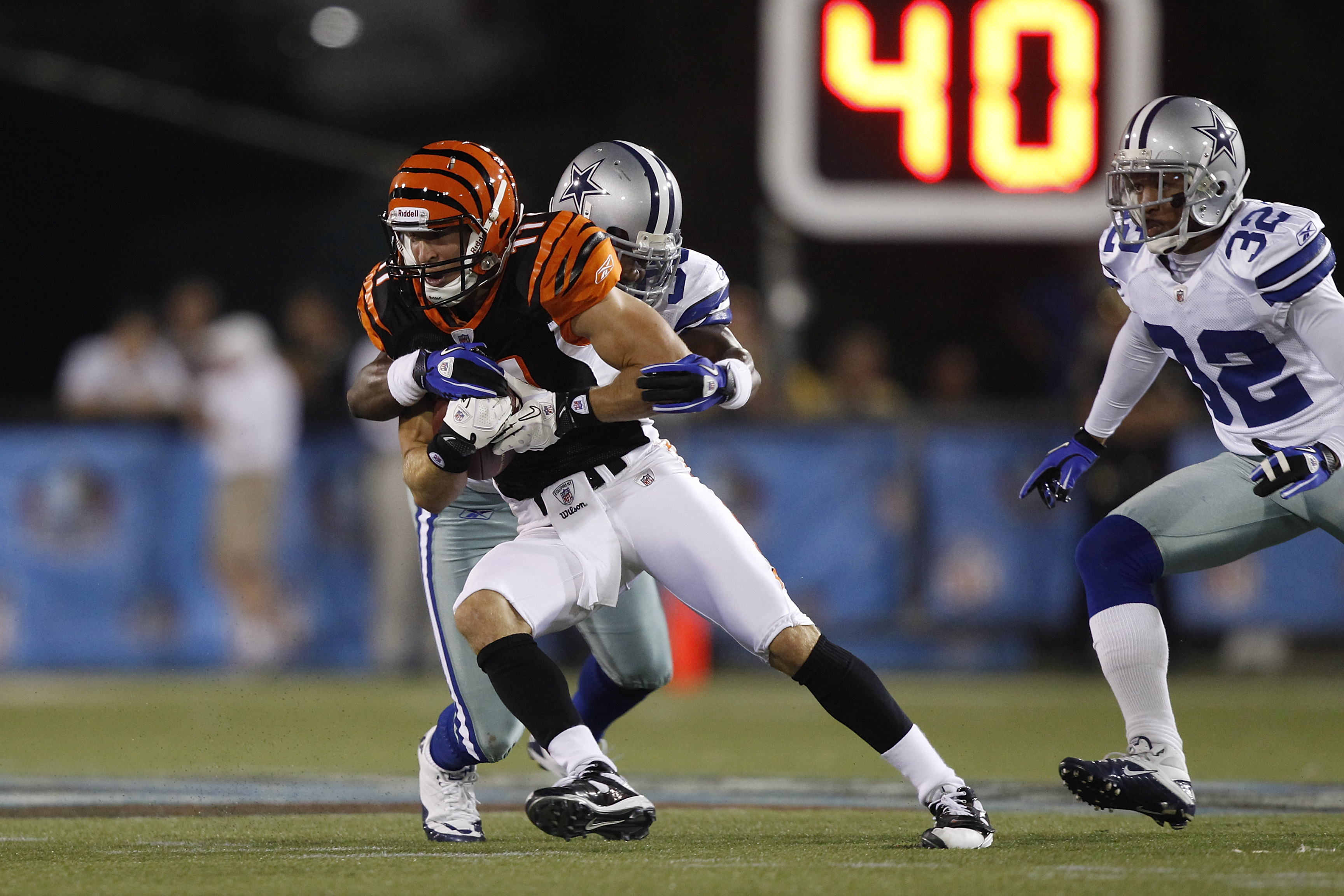 CANTON, OH - AUGUST 8: Jordan Shipley #11 of the Cincinnati Bengals tries to break a tackle after catching a pass against the Dallas Cowboys during the 2010 Pro Football Hall of Fame Game at the Pro Football Hall of Fame Field at Fawcett Stadium on August