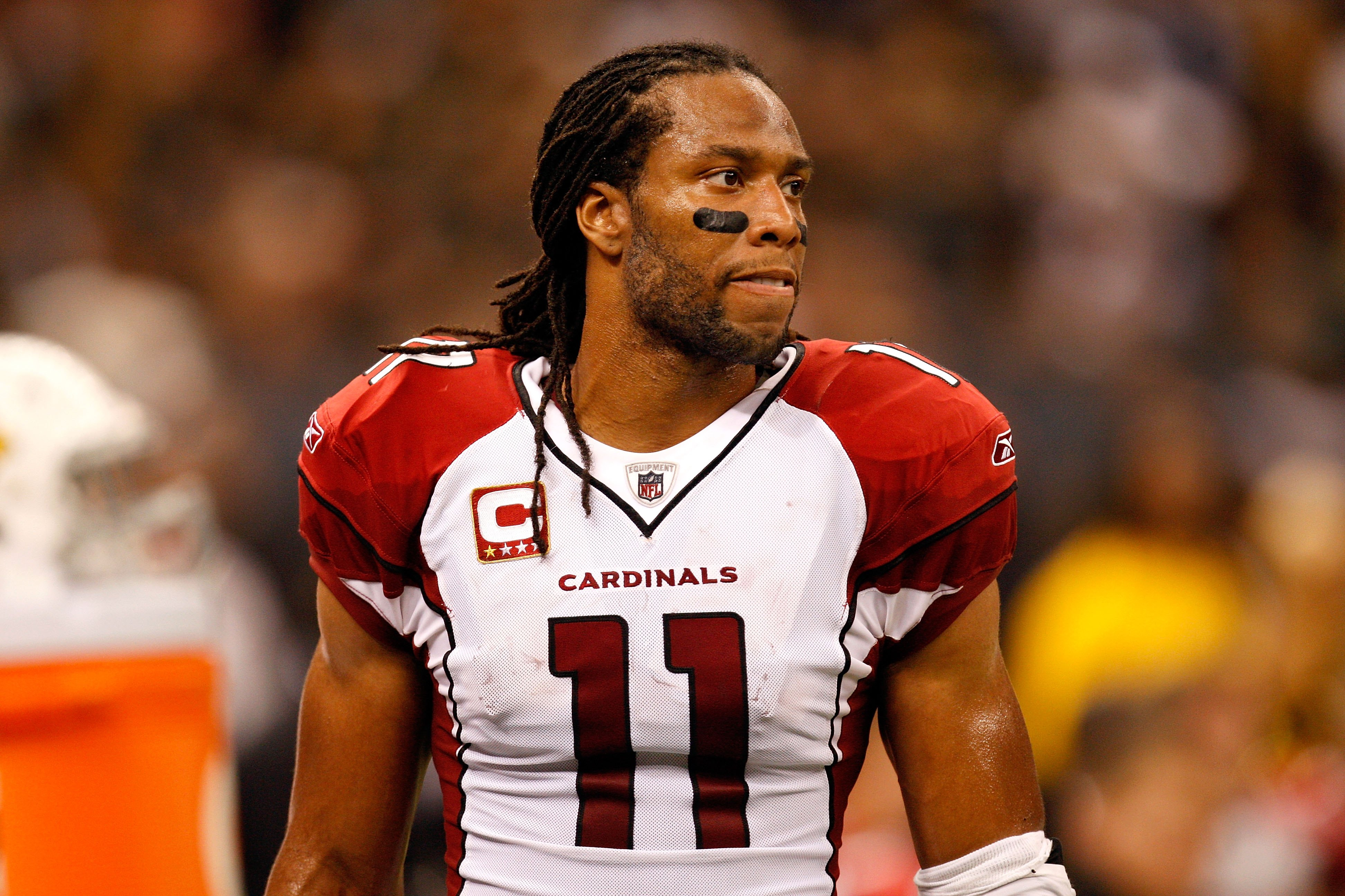 NEW ORLEANS - JANUARY 16:  Larry Fitzgerald #11 of the Arizona Cardinals looks on against the New Orleans Saints during the NFC Divisional Playoff Game at Louisana Superdome on January 16, 2010 in New Orleans, Louisiana. The Saints won 45-14.  (Photo by R