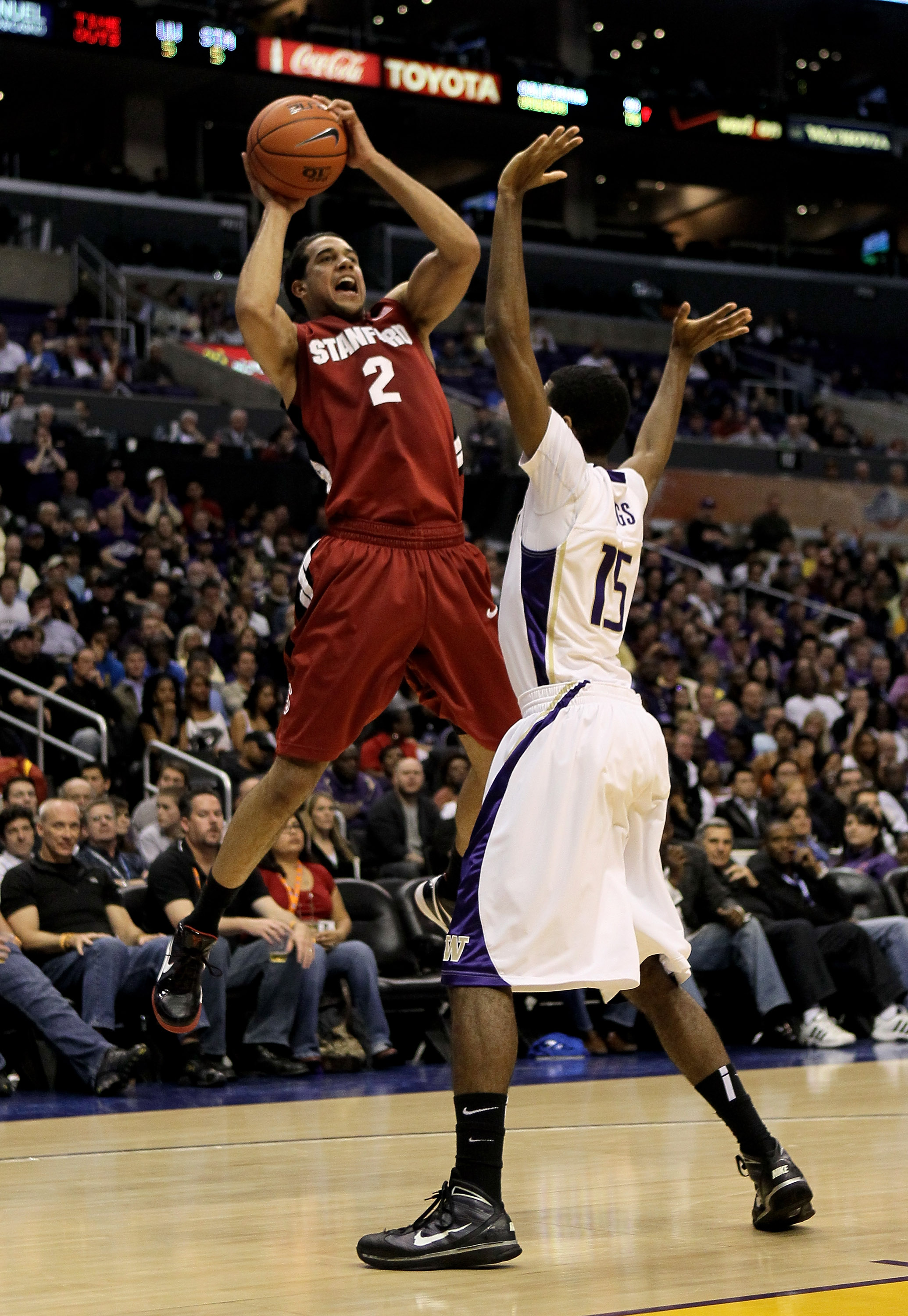 LOS ANGELES, CA - MARCH 12:  Landry Fields #2 of the Stanford Cardinal shoots over Scott Suggs #15 of the Washington Huskies during the semifinals of the Pac-10 Basketball Tournament at Staples Center on March 12, 2010 in Los Angeles, California.  (Photo