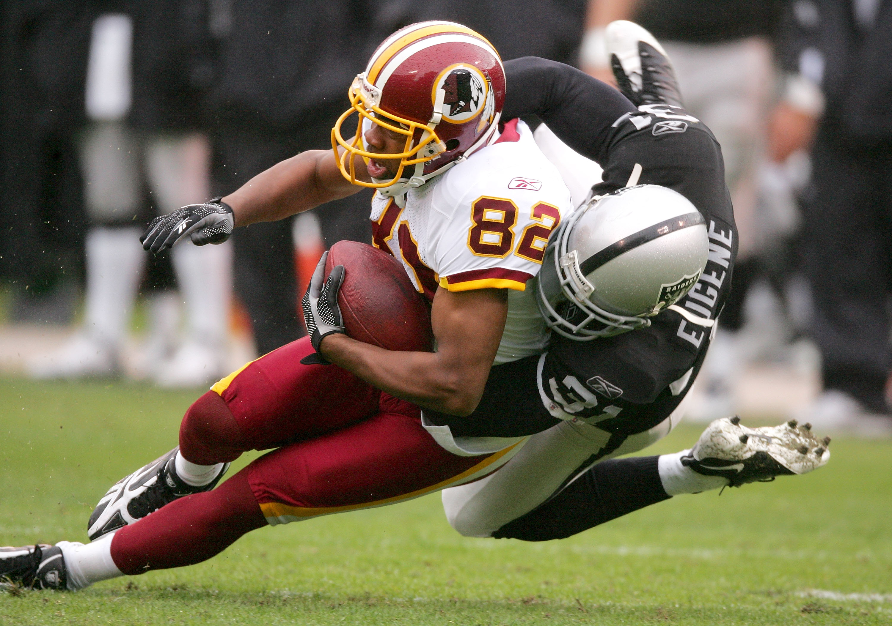 OAKLAND, CA - DECEMBER 13:  Antwaan Randle El #82 of the Washington Redskins is tackled by Hiram Eugene #31 of the Oakland Raiders at Oakland-Alameda County Coliseum on December 13, 2009 in Oakland, California.  (Photo by Ezra Shaw/Getty Images)
