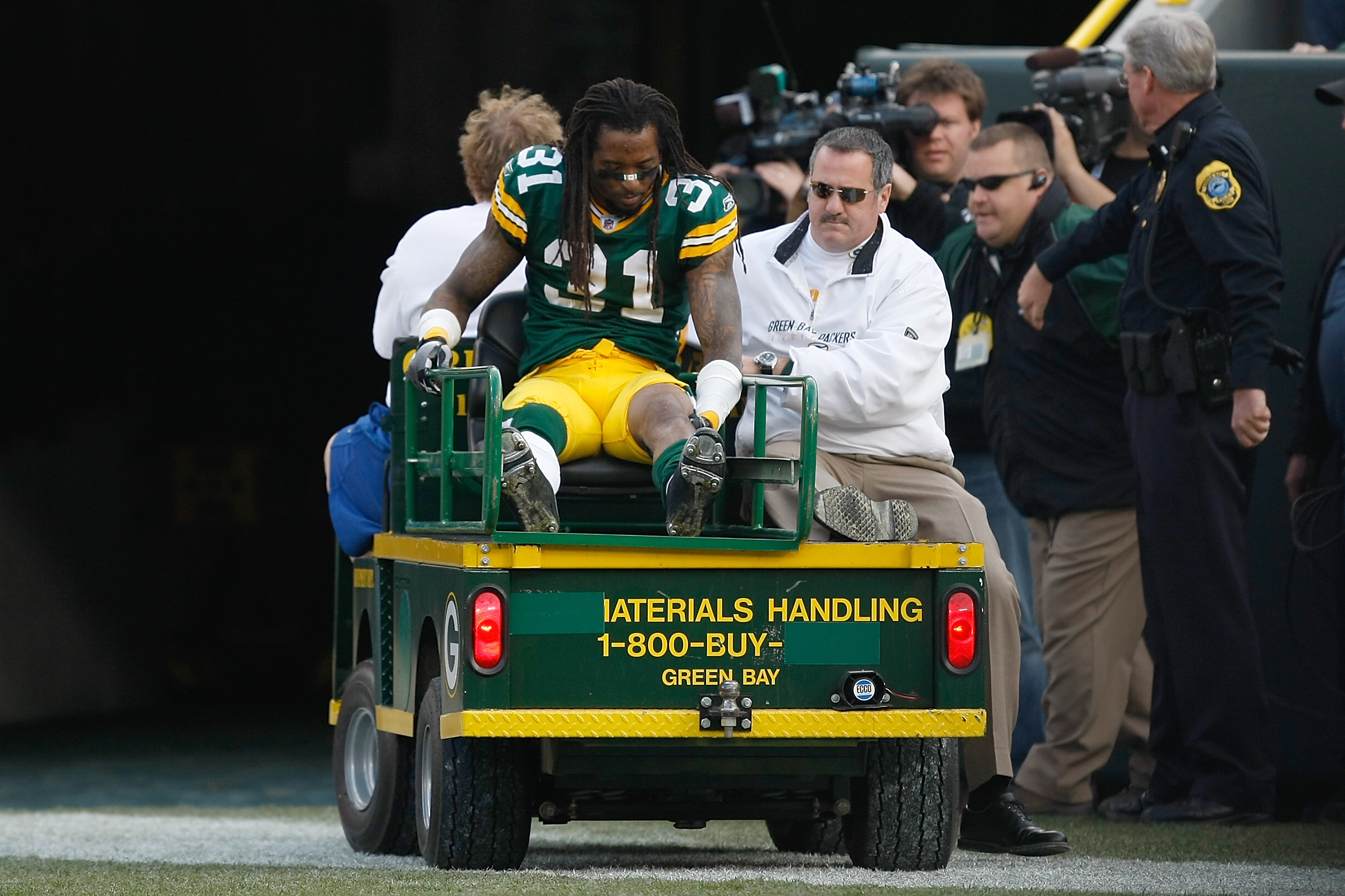 GREEN BAY, WI - NOVEMBER 22: Defensive back Al Harris #31 of the Green Bay Packers is taken off the field on a cart after an injury against the San Francisco 49ers at Lambeau Field on November 22, 2009 in Green Bay, Wisconsin. The Packers defeated the 49e