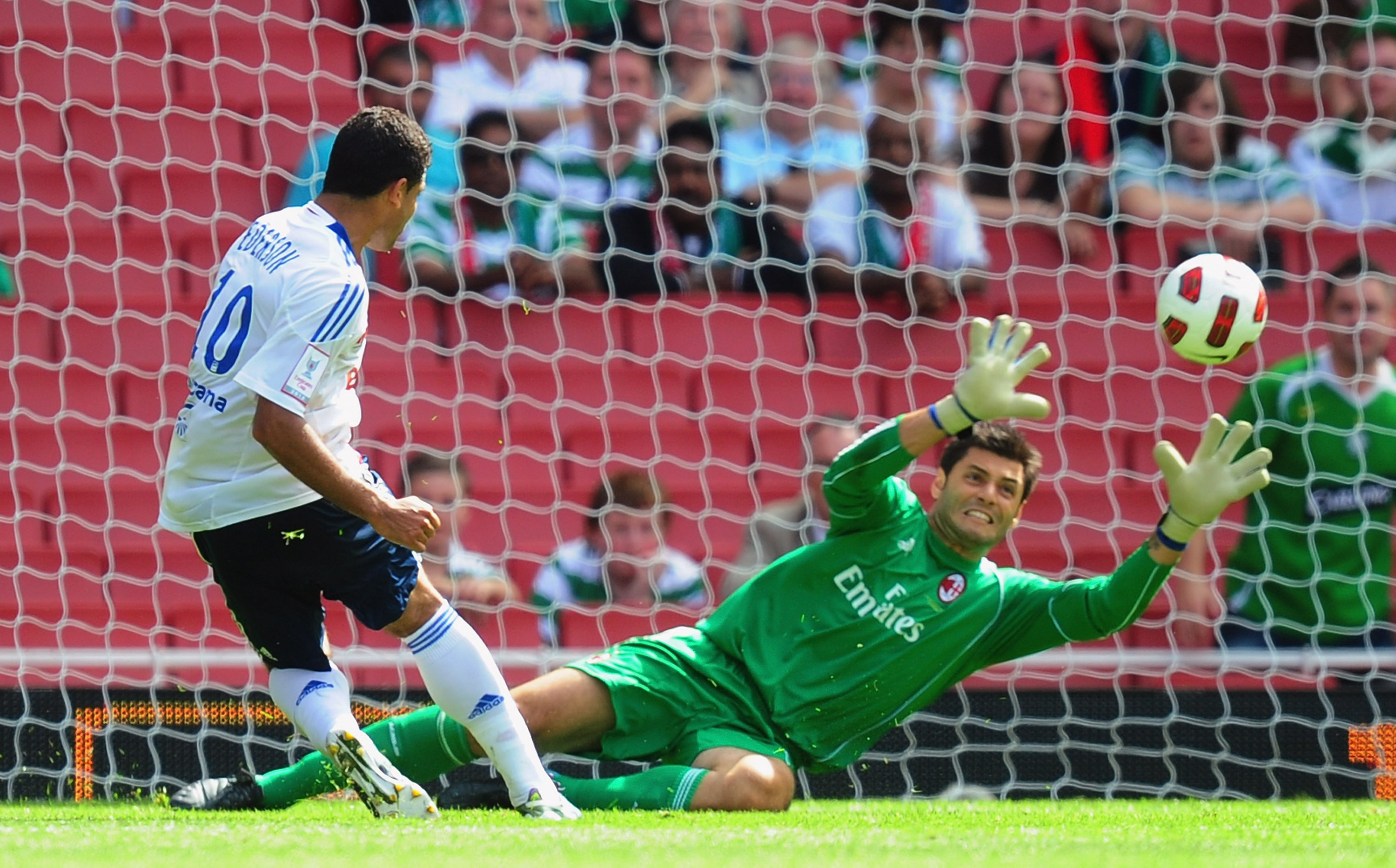 LONDON, ENGLAND - AUGUST 01:  Ederson of Lyon hits the bar as Marco Amelia of AC Milan dives during the Emirates Cup match between AC Milan and Lyon at Emirates Stadium on August 1, 2010 in London, England.  (Photo by Mike Hewitt/Getty Images)