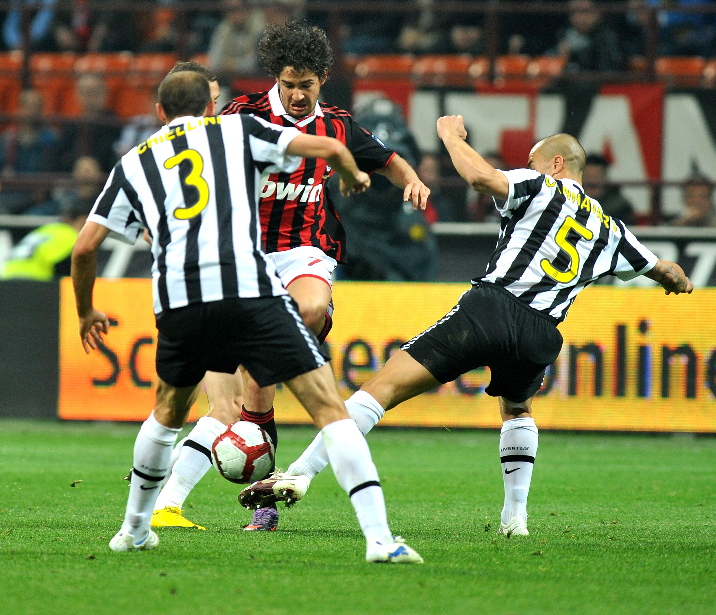 MILAN, ITALY - MAY 15: Alexandre Pato of AC Milan battles for the ball against Giorgio Chiellini and Fabio Cannavaro of Juventus FC during the Serie A match between AC Milan and Juventus FC at Stadio Giuseppe Meazza on May 15, 2010 in Milan, Italy.  (Phot