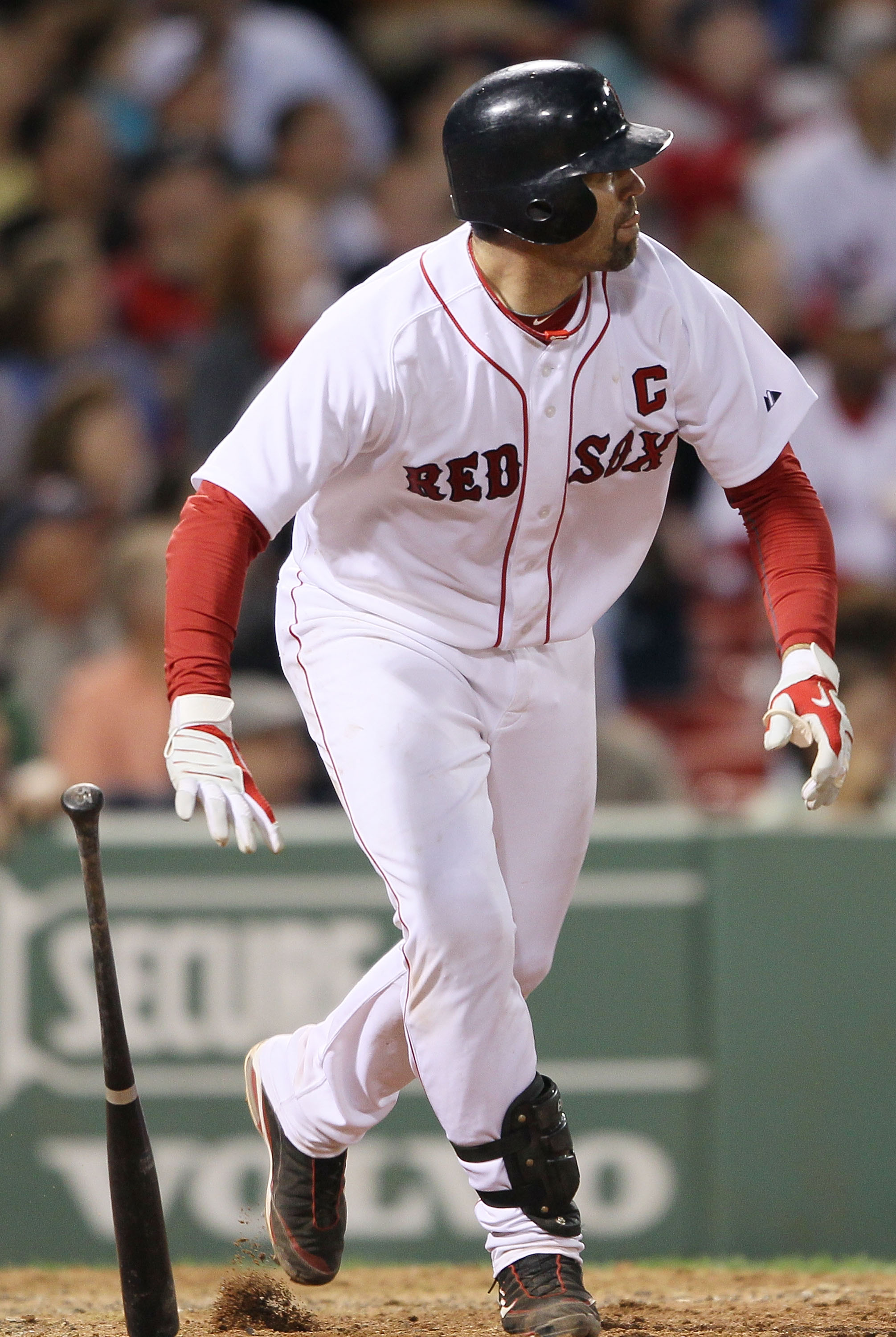 BOSTON - MAY 27:  Jason Varitek #33 of the Boston Red Sox hits an RBI double in the sixth inning against the Kansas City Royals on May 27, 2010 at Fenway Park in Boston, Massachusetts.  (Photo by Elsa/Getty Images)
