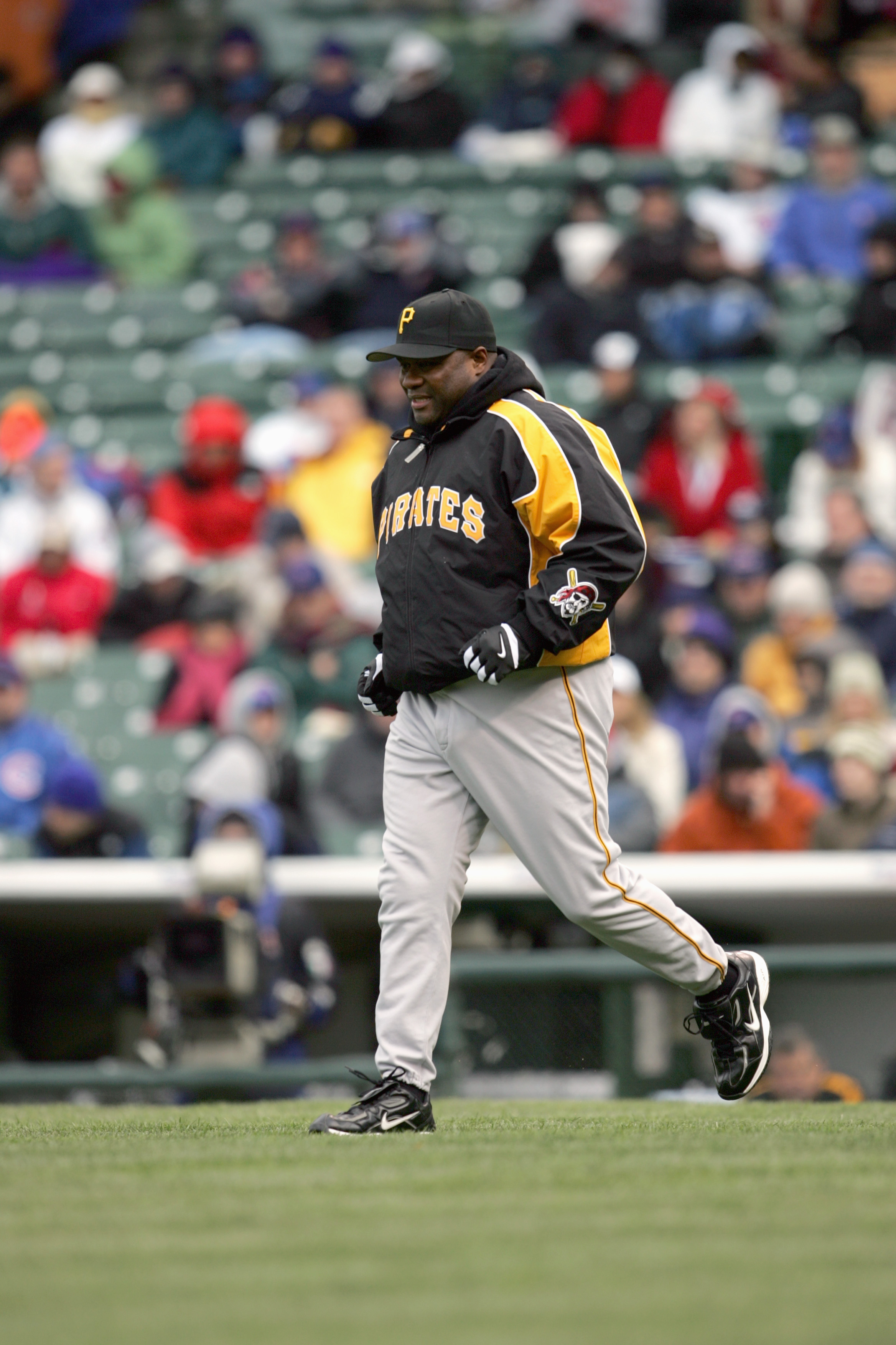 CHICAGO - APRIL 23:  Manager Lloyd McClendon of the Pittsburgh Pirates jogs to the mound during the game against the Chicago Cubs on April 23, 2005 at Wrigley Field in Chicago, Illinois. The Pirates defeated the Cubs 4-3. (Photo by Jonathan Daniel/Getty I
