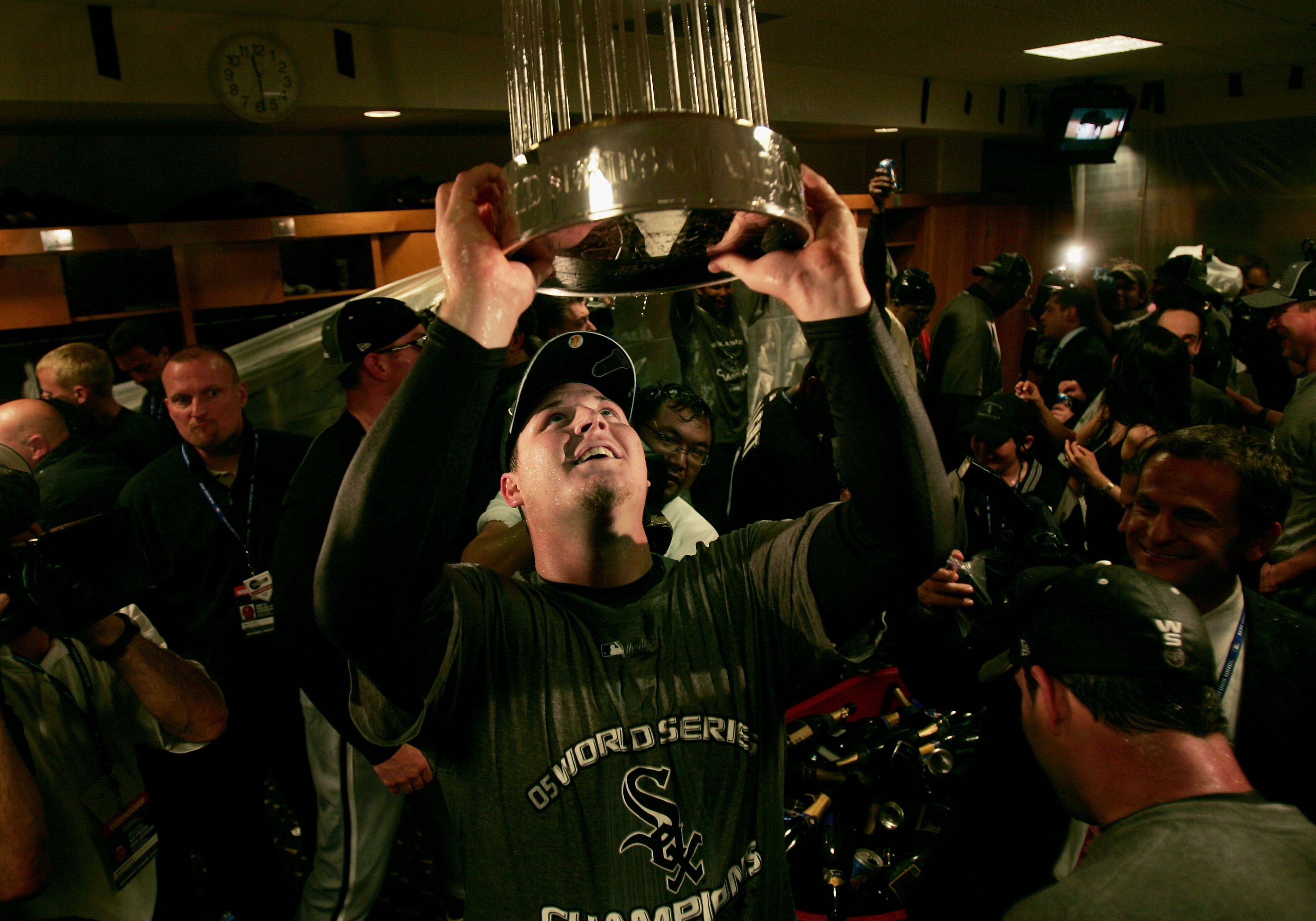 HOUSTON - OCTOBER 26:  Pitcher Bobby Jenks #45 of the Chicago White Sox celebrates in the locker room with the championship trophy after winning Game Four of the 2005 Major League Baseball World Series against the Houston Astros at Minute Maid Park on Oct