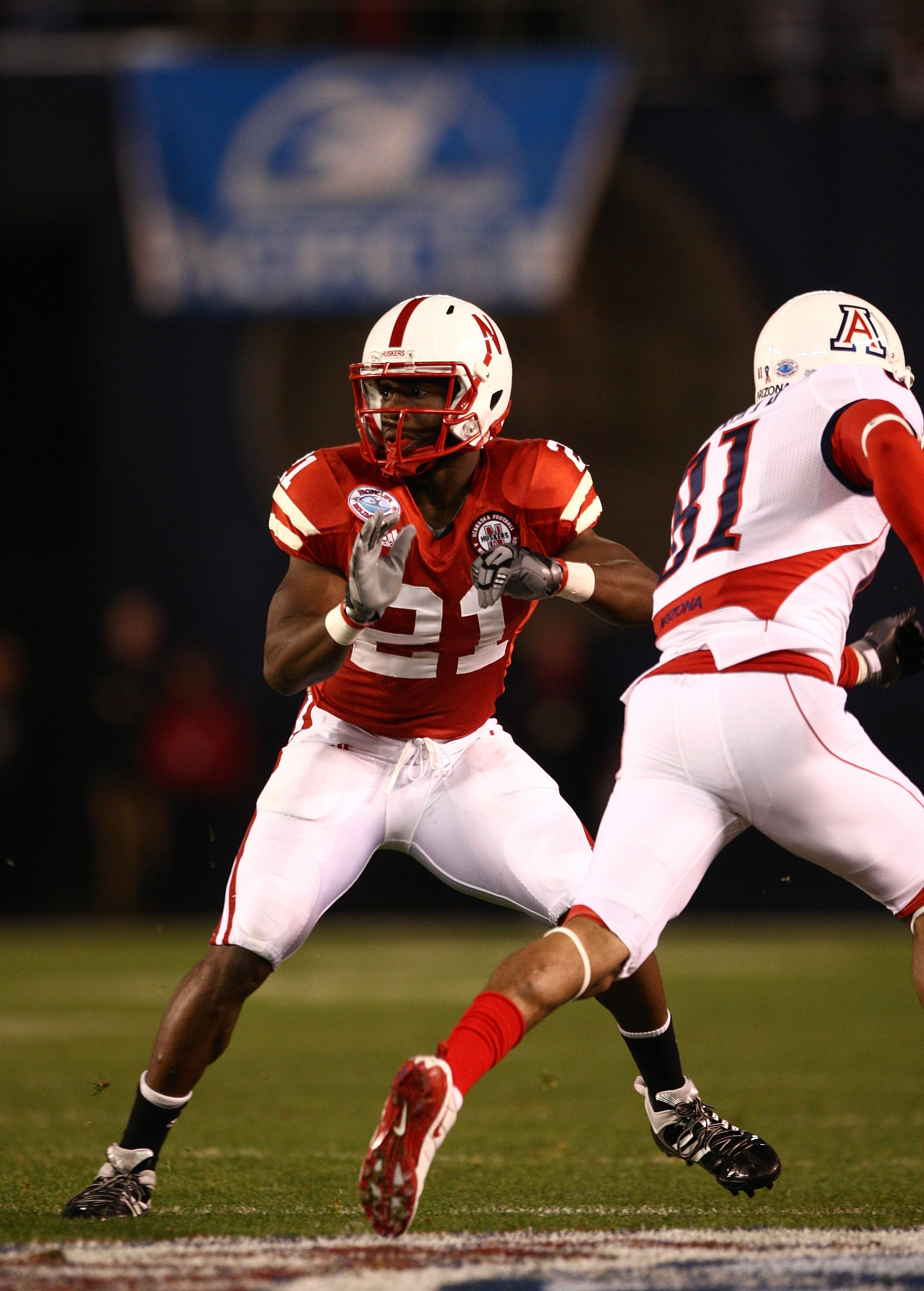 SAN DIEGO - DECEMBER 30:  Prince Amukamara #21 of the University of Nebraska Cornhuskers defends the play during the Pacific Life Holiday Bowl against University of Arizona Wildcats on December 30, 2009 at Qualcomm Stadium in San Diego, California. The Co