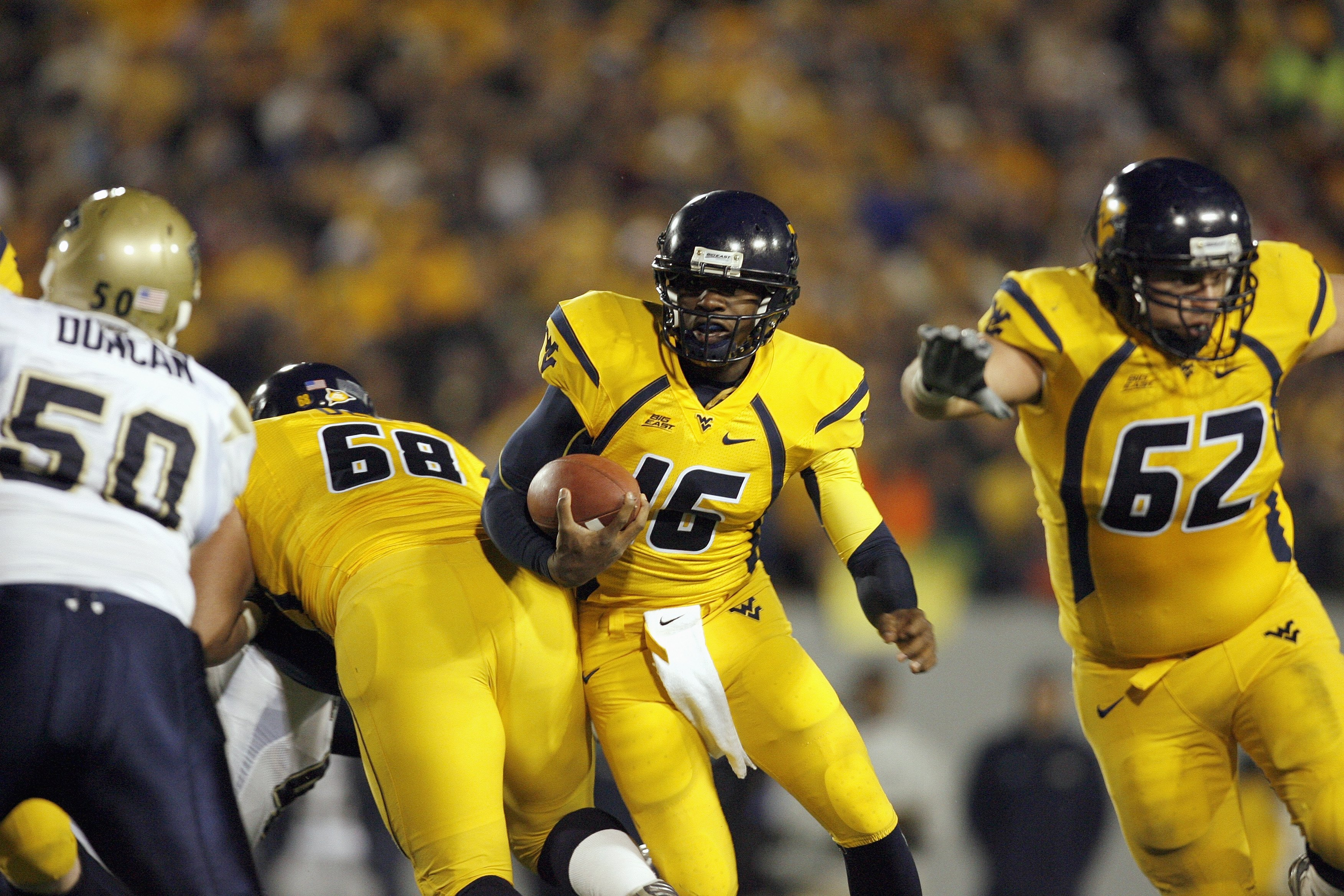 MORGANTOWN, WV - DECEMBER 1: Jarrett Brown #16 of the West Virginia Mountaineers carries the ball during the game against the Pittsburgh Panthers at Milan Puskar Stadium on December 1, 2007 in Morgantown, West Virginia. (Photo by Kevin C. Cox/Getty Images