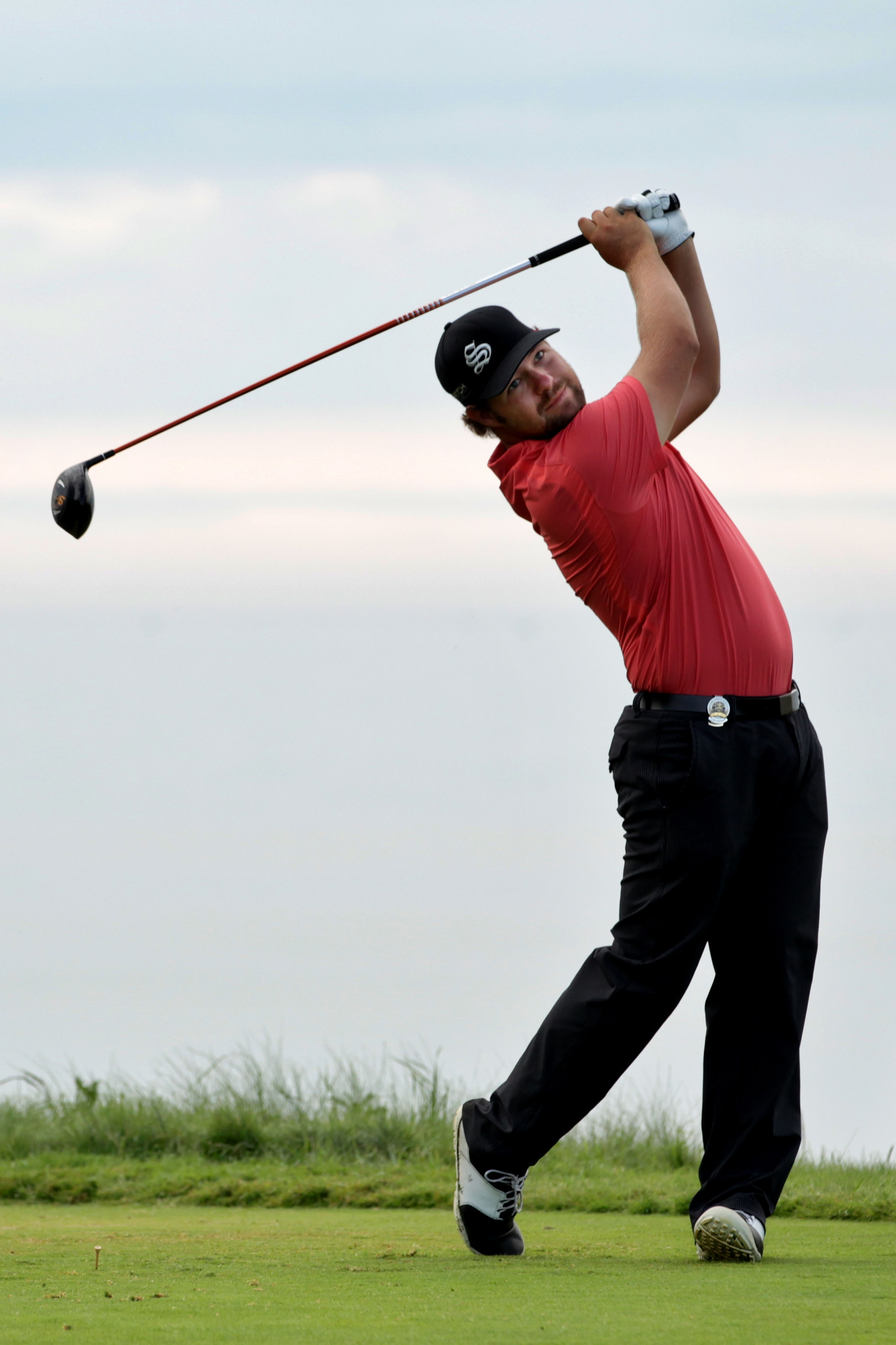 KOHLER, WI - AUGUST 14:  Ryan Moore hits his tee shot on the ninth hole during the continuation of the second round of the 92nd PGA Championship on the Straits Course at Whistling Straits on August 14, 2010 in Kohler, Wisconsin.  (Photo by Andrew Redingto