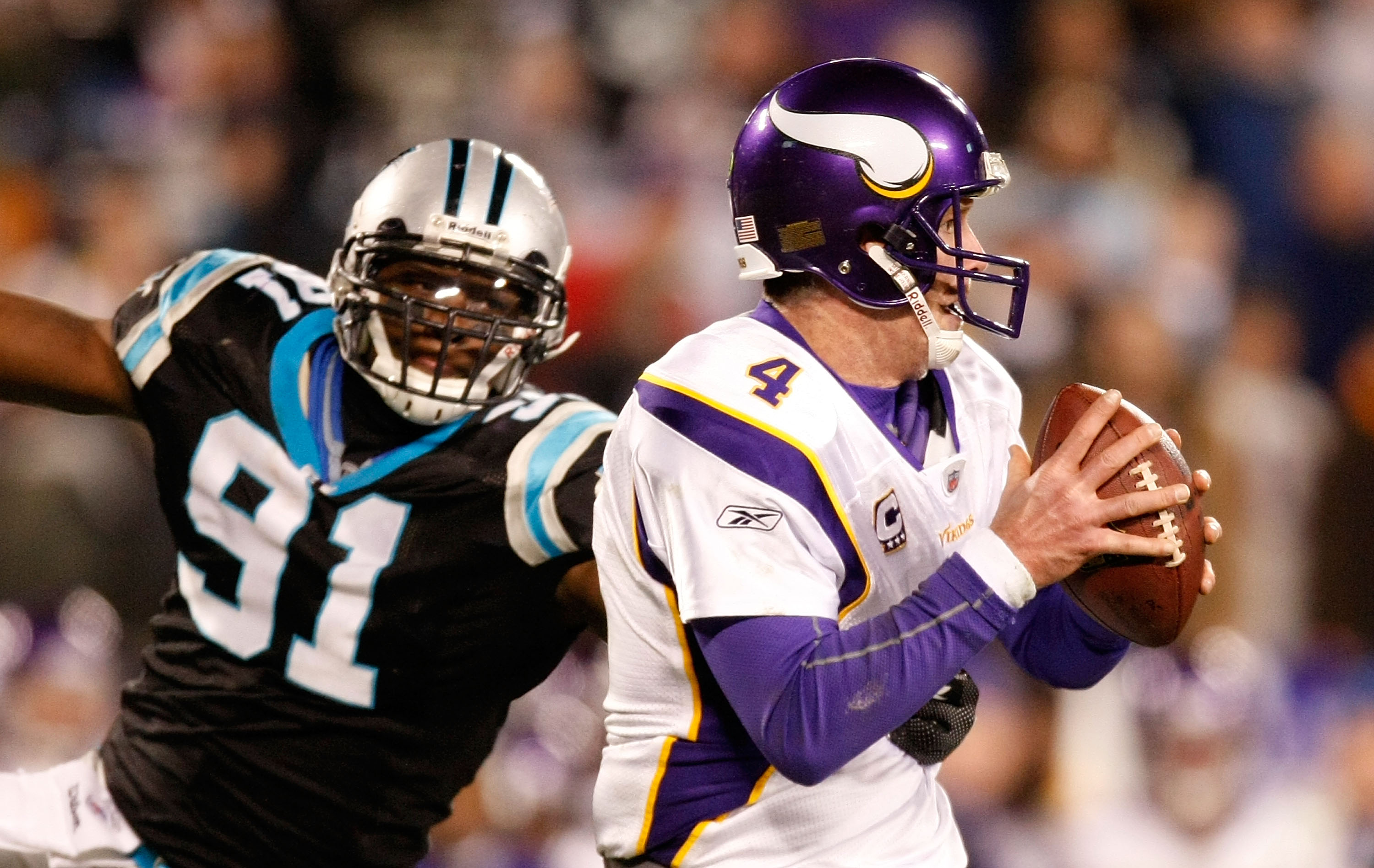 CHARLOTTE, NC - DECEMBER 20:  Quarterback Brett Favre #4 of the Minnesota Vikings is pressured by Everette Brown #91 of the Carolina Panthers at Bank of America Stadium on December 20, 2009 in Charlotte, North Carolina.  (Photo by Kevin C. Cox/Getty Image