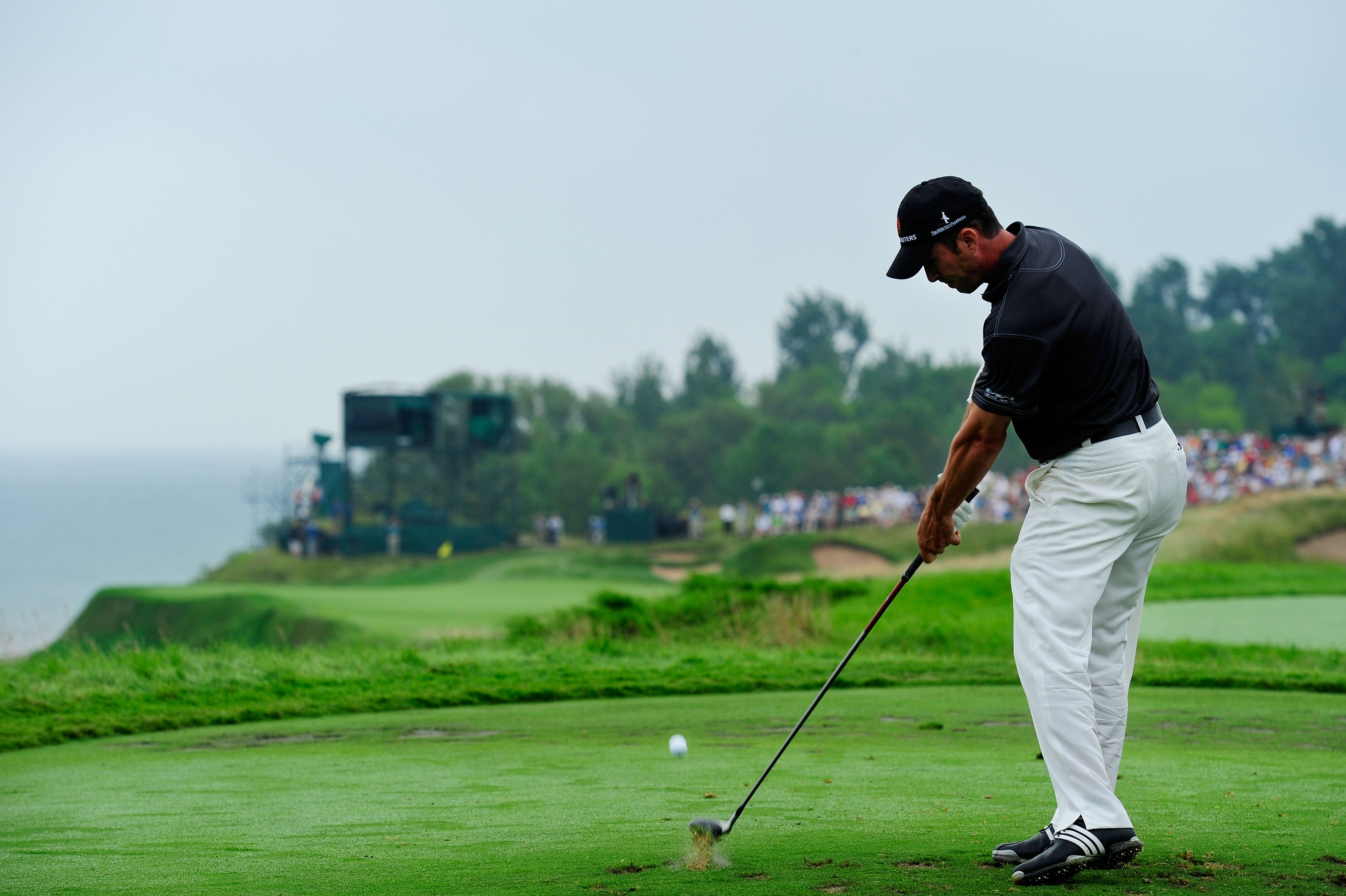 KOHLER, WI - AUGUST 13:  Mike Weir of Canada hits his tee shot on the 17th hole during the continuation of the first round of the 92nd PGA Championship on the Straits Course at Whistling Straits on August 13, 2010 in Kohler, Wisconsin.  (Photo by Stuart F