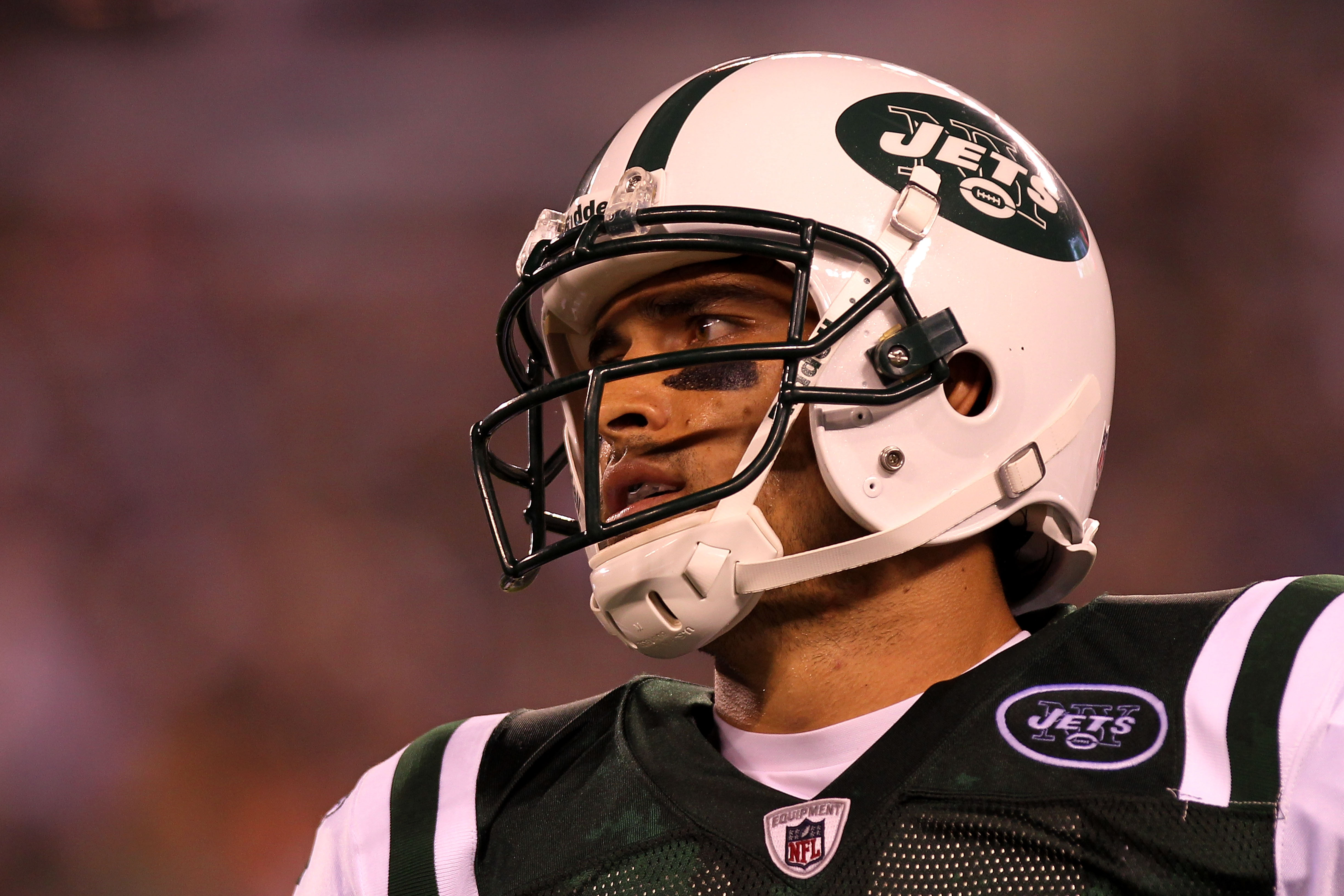 EAST RUTHERFORD, NJ - AUGUST 16:  Quarterback Mark Sanchez #6 of the New York Jets walks off the field against the New York Giants during their game at New Meadowlands Stadium on August 16, 2010 in East Rutherford, New Jersey.  (Photo by Nick Laham/Getty
