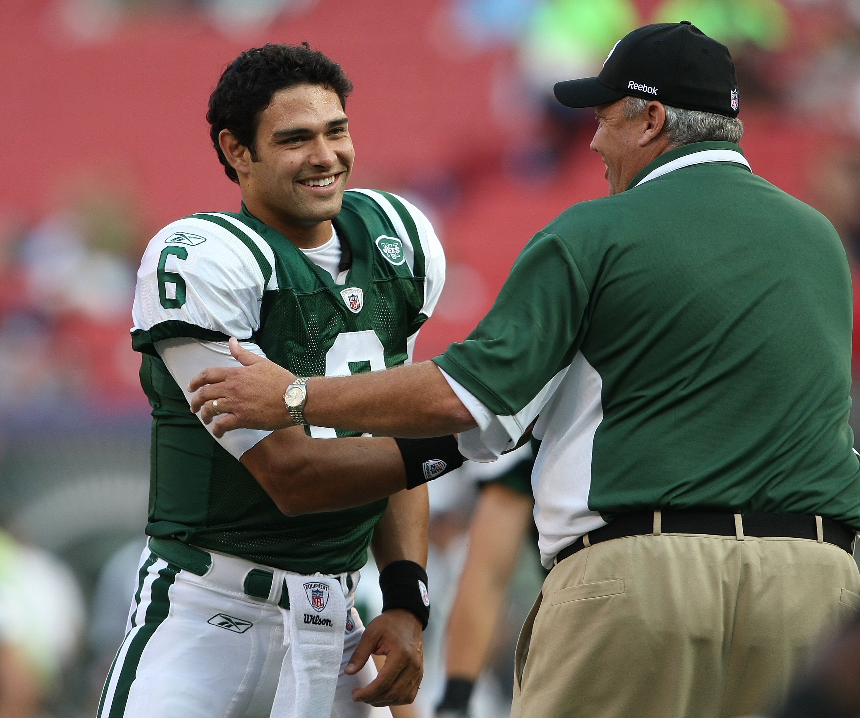 EAST RUTHERFORD, NJ - AUGUST 14:  Mark Sanchez #6 of the New York Jets shakes hands with head coach Rex Ryan prior to the preseason game against the St. Louis Rams at Giants Stadium on August 14, 2009  in East Rutherford, New Jersey.  (Photo by Nick Laham