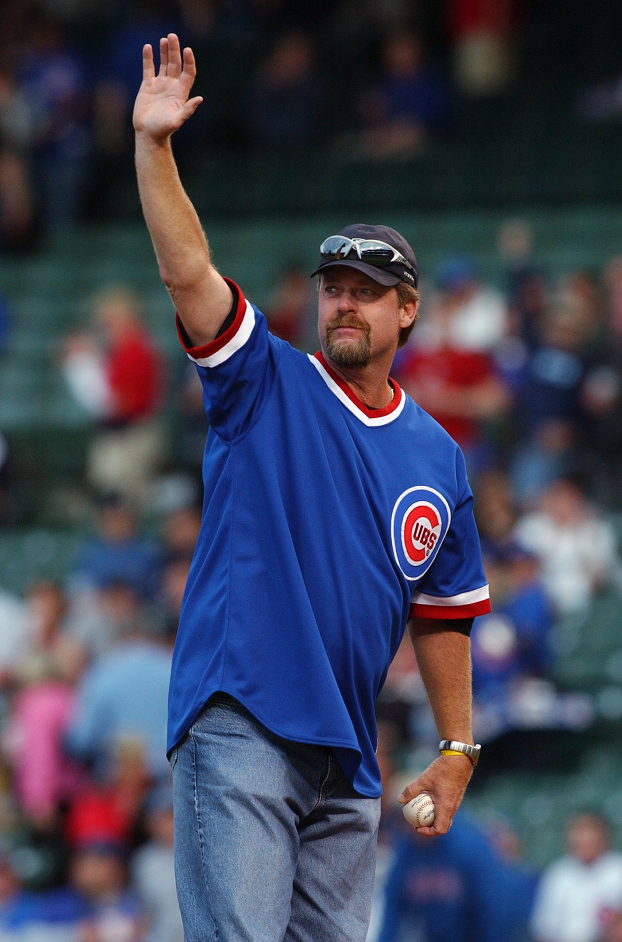 CHICAGO - JUNE 1:  Former Chicago Cubs pitcher Rick Sutcliffe now an ESPN Announcer, throws out the first pitch before the game between the Houston Astros and the Chicago Cubs on June 1, 2004 at Wrigley Field in Chicago, Illinois. The Astros defeated the