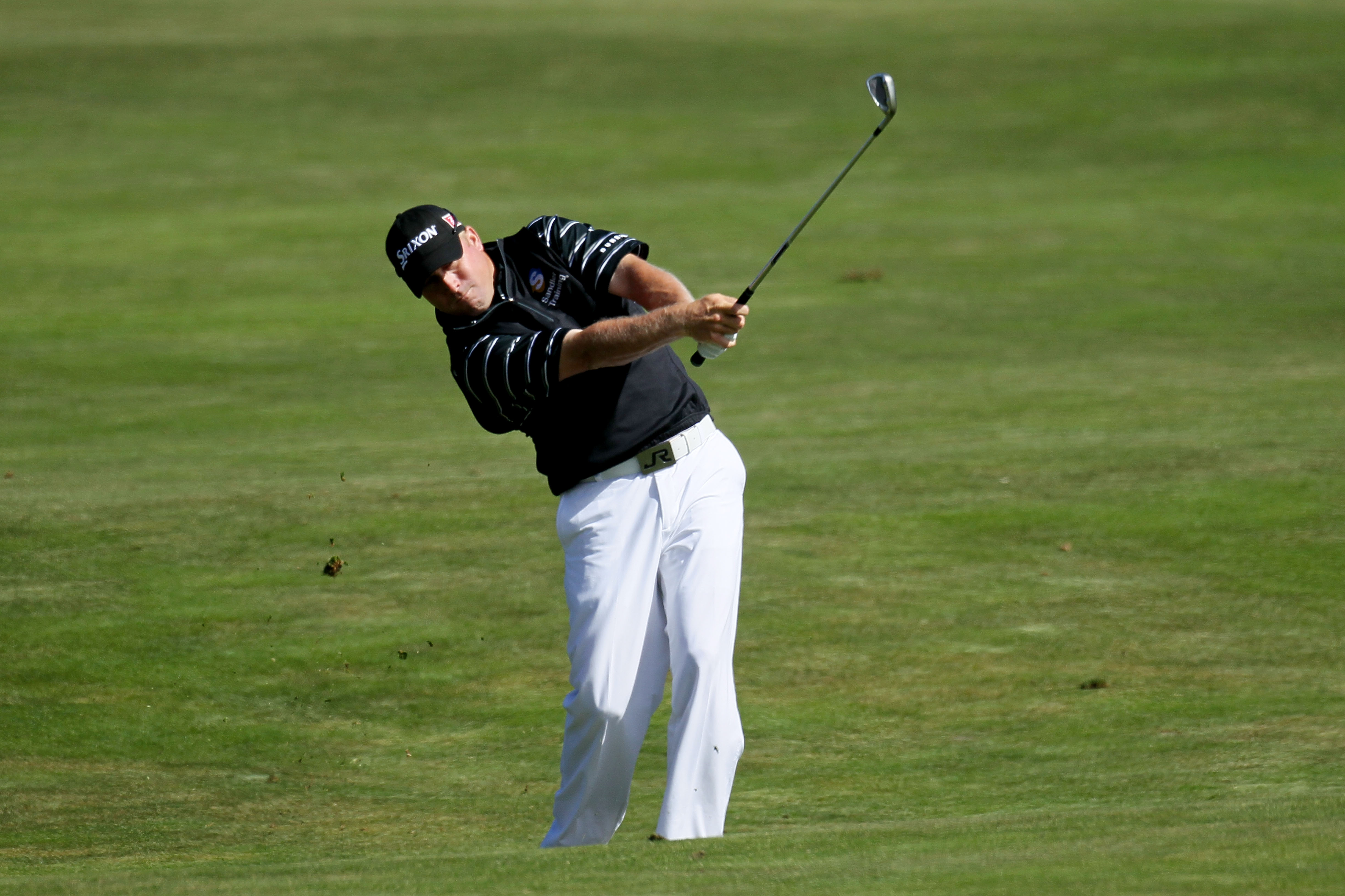PEBBLE BEACH, CA - JUNE 17:  John Rollins plays his second shot on the 15th hole during the first round of the 110th U.S. Open at Pebble Beach Golf Links on June 17, 2010 in Pebble Beach, California.  (Photo by Stephen Dunn/Getty Images)
