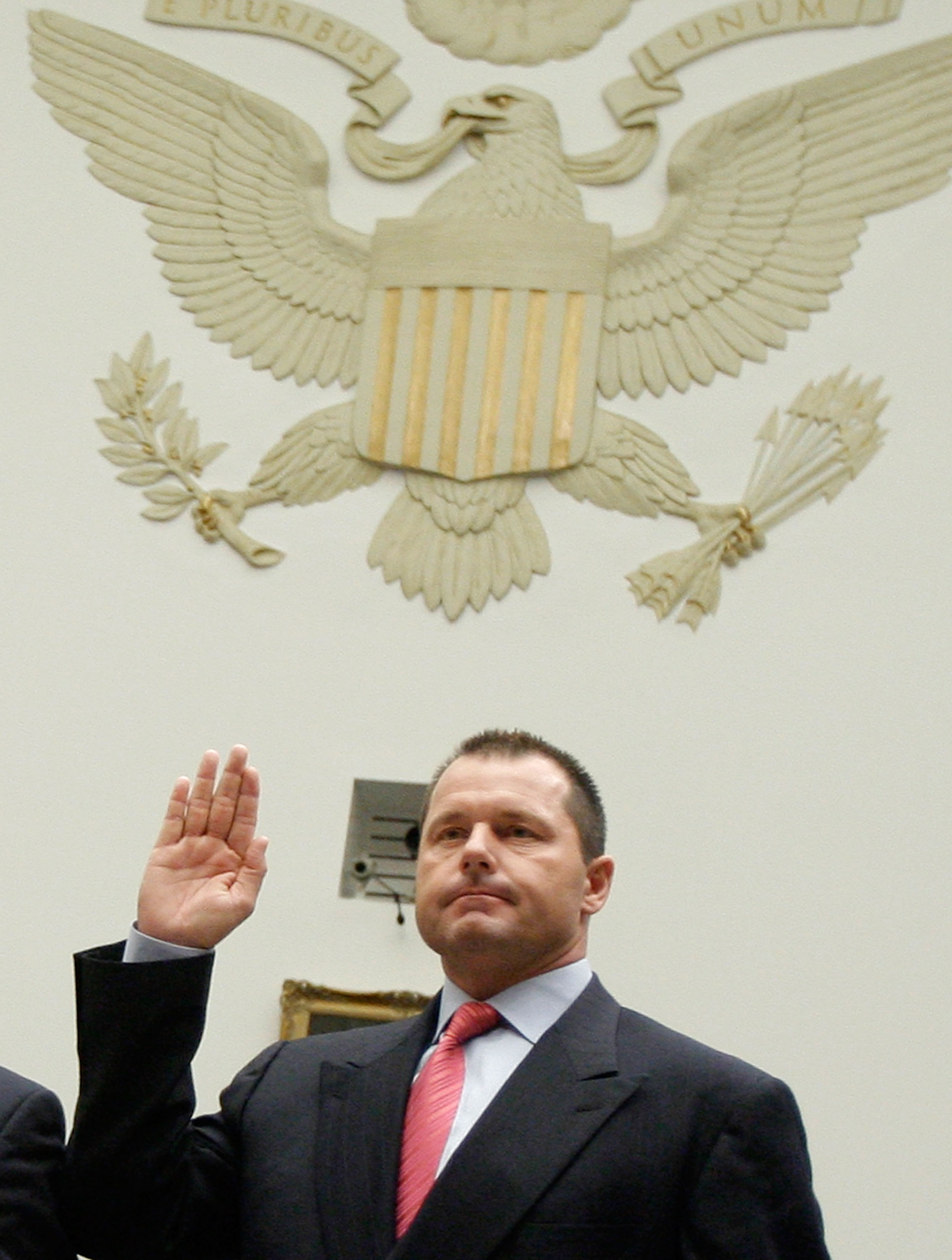 WASHINGTON - FEBRUARY 13:  Major League Baseball player Roger Clemens raises his right hand as he is sworn in during a House Oversight and Government Reform Committee, February 13, 2008 in Washington DC. The committee is hearing testimony on the use the i