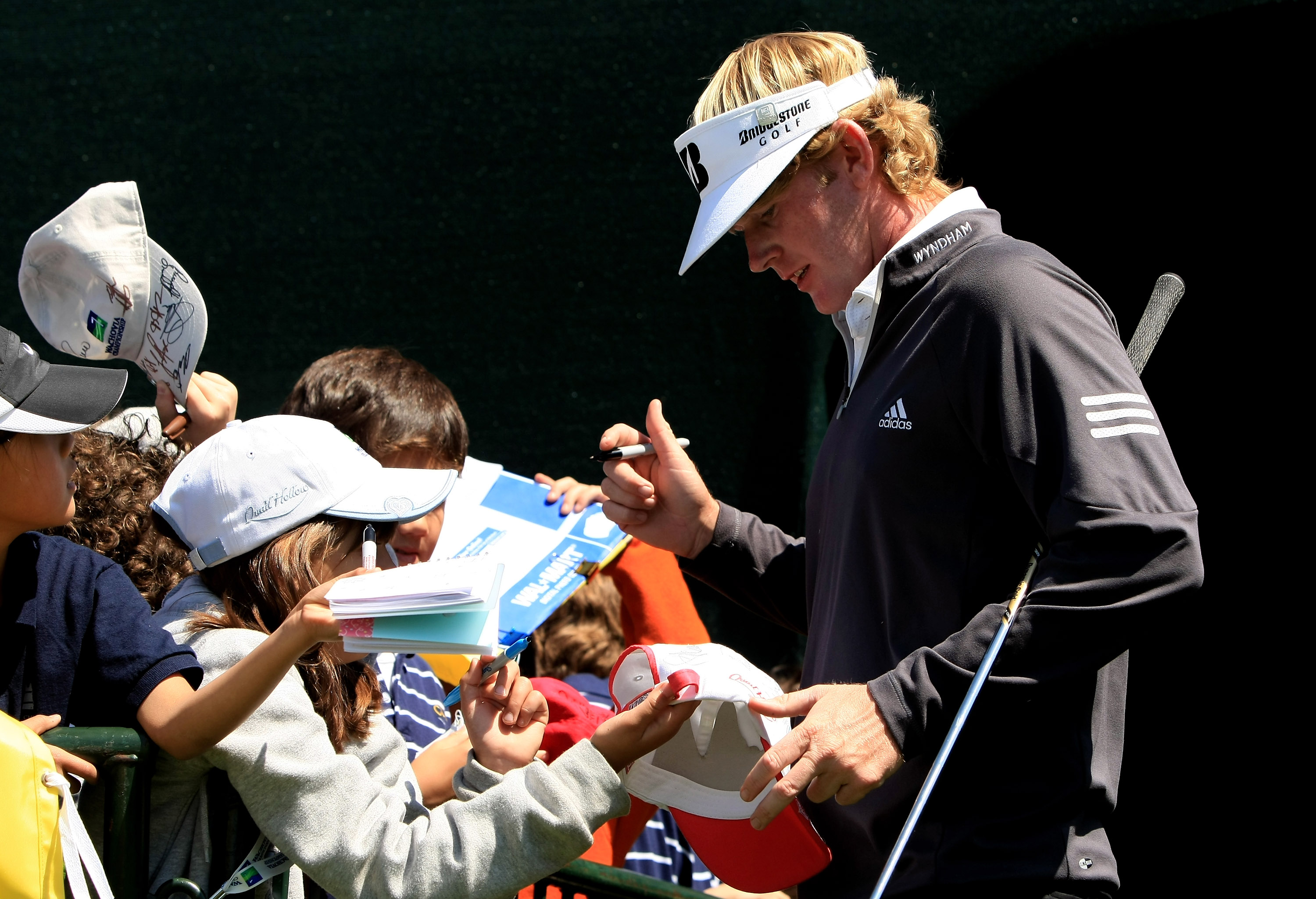 CHARLOTTE, NC - APRIL 29:  Brandt Snedker signs autograpghs for young fans during the Tuesday practice round for the Wachovia Championship at Quail Hollow Country Club on April 29, 2008 Charlotte, North Carolina.  (Photo by Richard Heathcote/Getty Images)