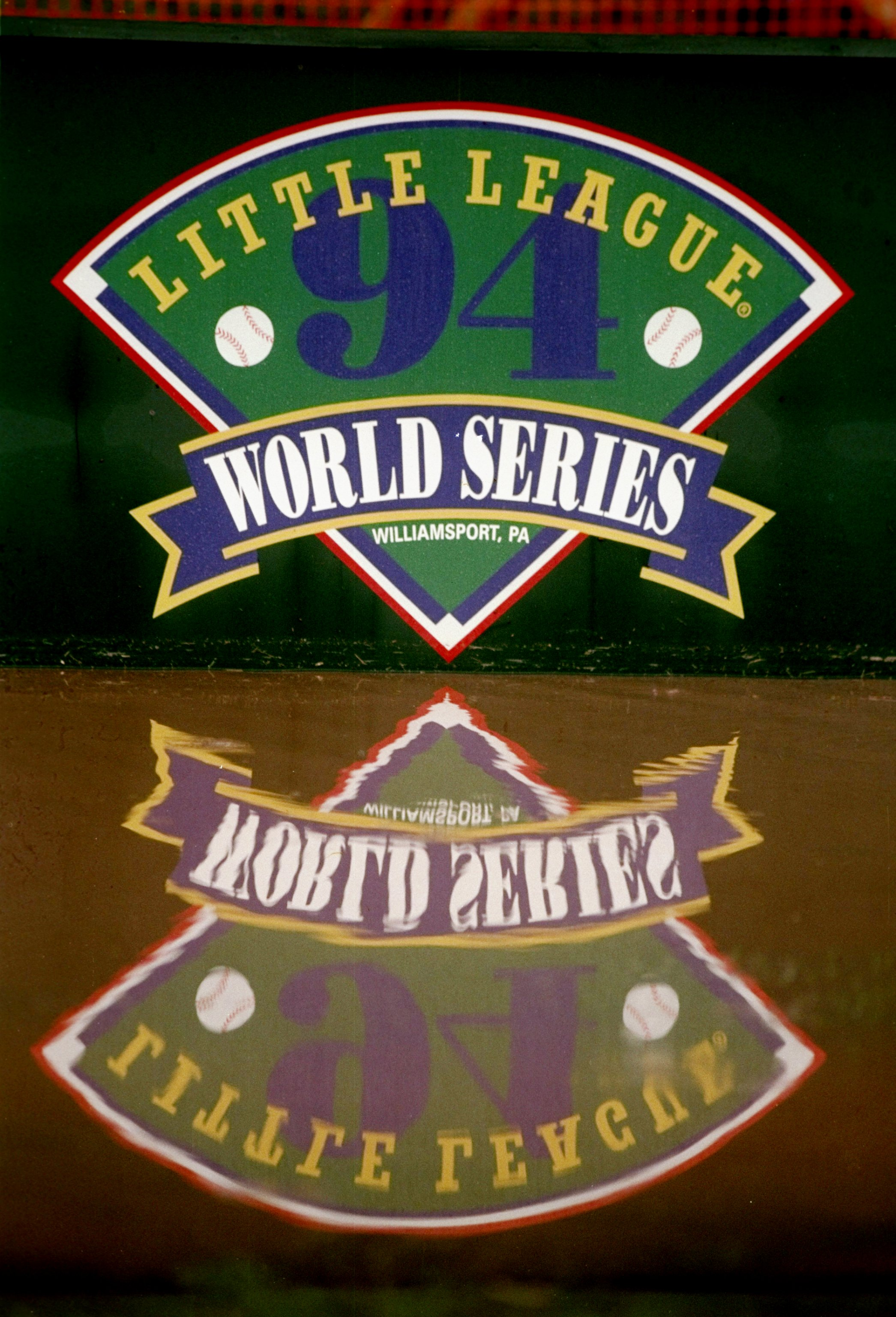 27 Aug 1994:  General view of a World Series banner reflected in a rain puddle during a delay in a Little League World Series game between  Northridge and Venezuela.  Venezuela won the game 4-3. Mandatory Credit: Todd Rosenberg  /Allsport