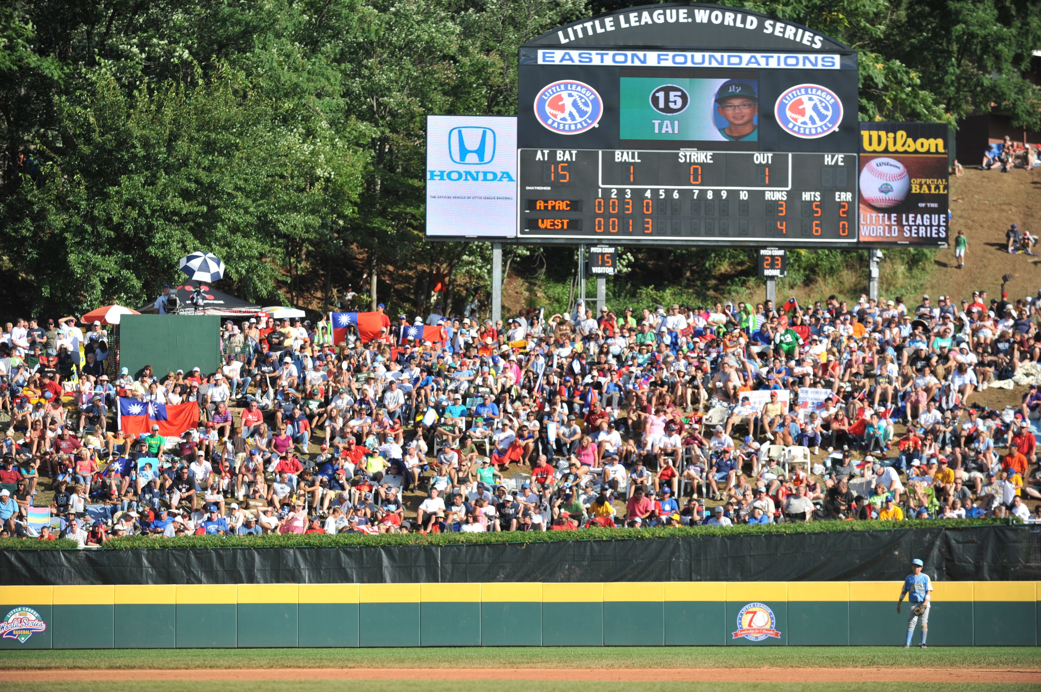 WILLIAMSPORT, PA - AUGUST 30: Fans of the little league world series watch the game between California (Chula Vista)and Asia Pacific (Taoyuan, Taiwan) in the little league world series final at Lamade Stadium on August 30, 2009 in Williamsport, Pennsylvan