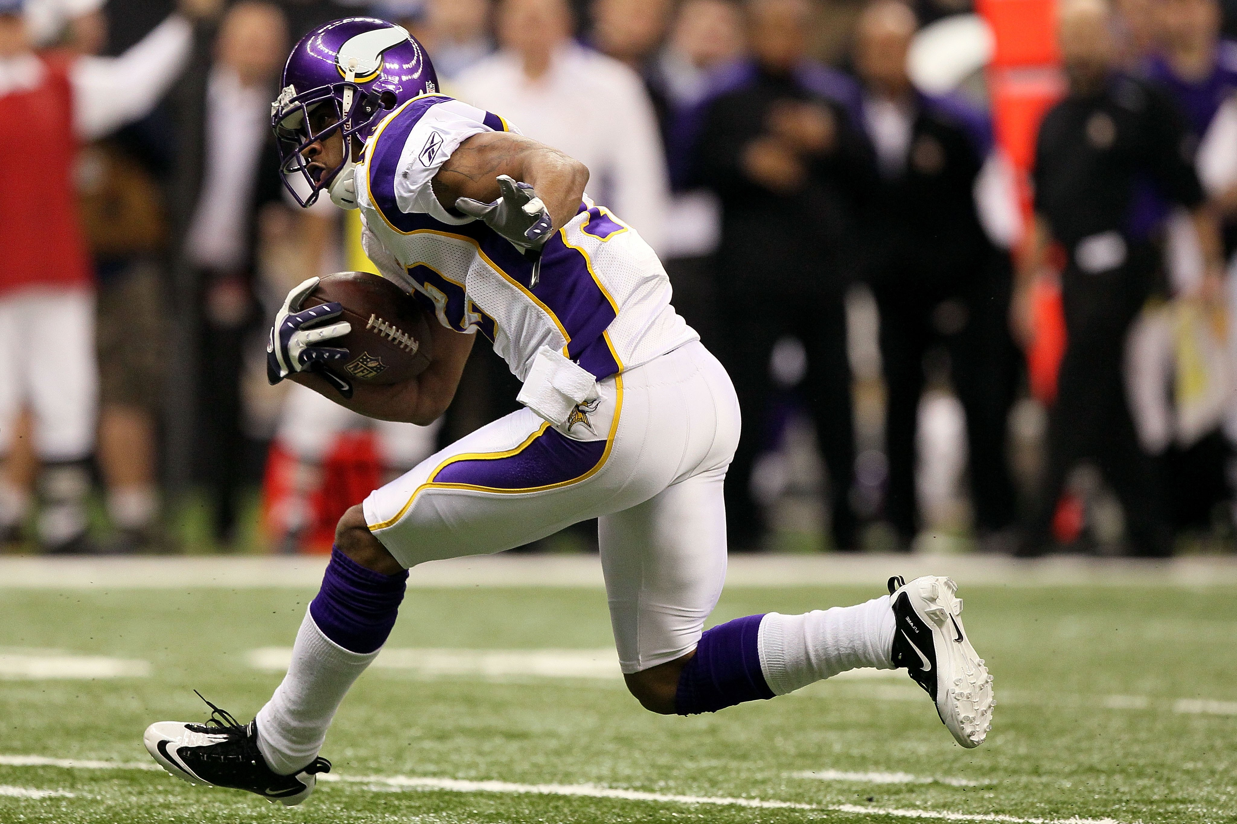 NEW ORLEANS - JANUARY 24:  Percy Harvin #12 of the Minnesota Vikings returns a punt against the New Orleans Saints during the NFC Championship Game at the Louisiana Superdome on January 24, 2010 in New Orleans, Louisiana. The Saints won 31-28 in overtime.
