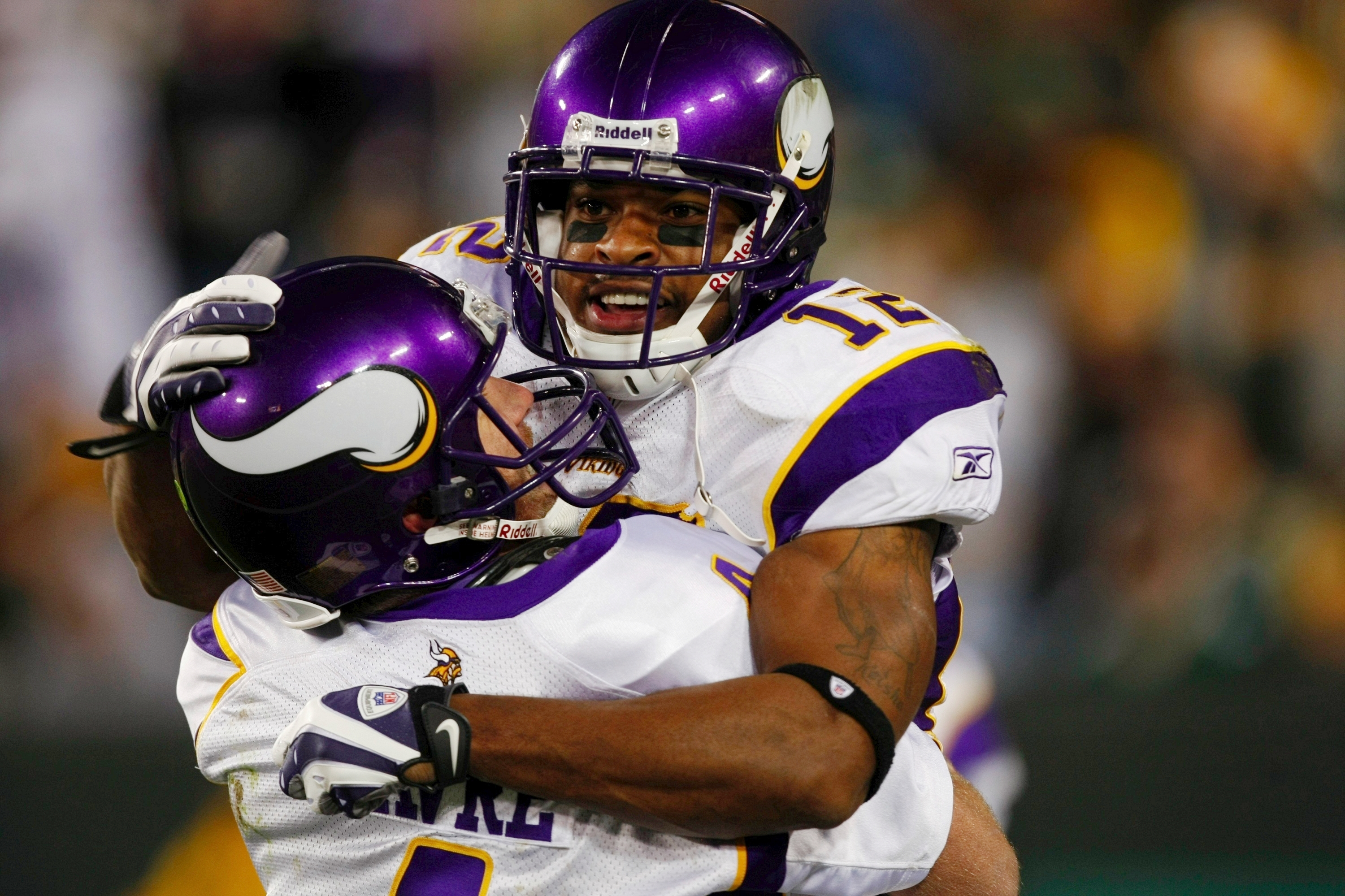 GREEN BAY, WI - NOVEMBER 01: Quarterback Brett Favre #4 of the Minnesota Vikings celebrates with teammate Percy Harvin #12 after a 51 yard touchdown pass during the third quarter of the game against the Green Bay Packers at Lambeau Field on November 1, 20