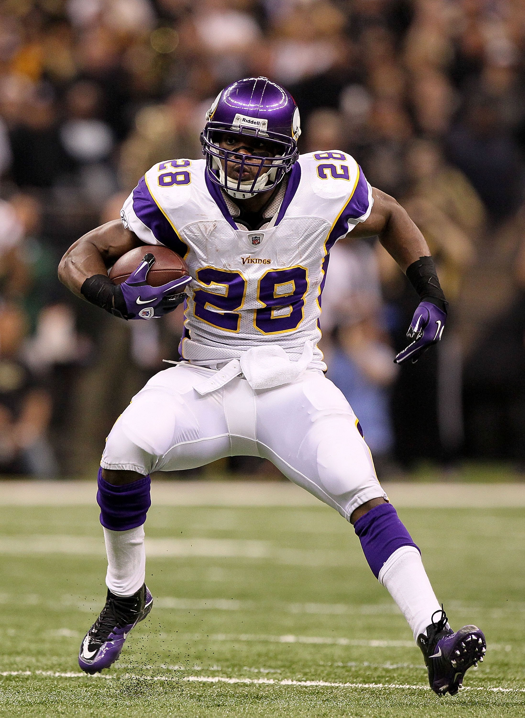 NEW ORLEANS - JANUARY 24:  Adrian Peterson #28 of the Minnesota Vikings runs with the ball against the New Orleans Saints during the NFC Championship Game at the Louisiana Superdome on January 24, 2010 in New Orleans, Louisiana. The Saints won 31-28 in ov