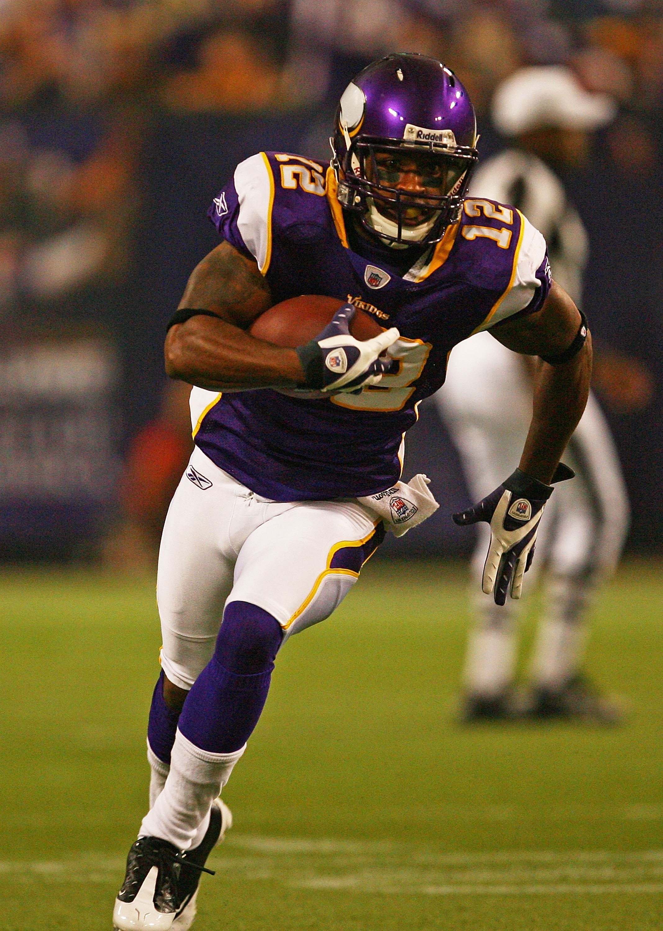 MINNEAPOLIS - SEPTEMBER 27: Percey Harvin #12 of the Minnesota Vikings runs with the ball against the San Francisco 49ers at the Hubert H. Humphrey Metrodome on September 27, 2009 in Minneapolis, Minnesota. The Vikings defeated the 49ers 27-24.  (Photo by