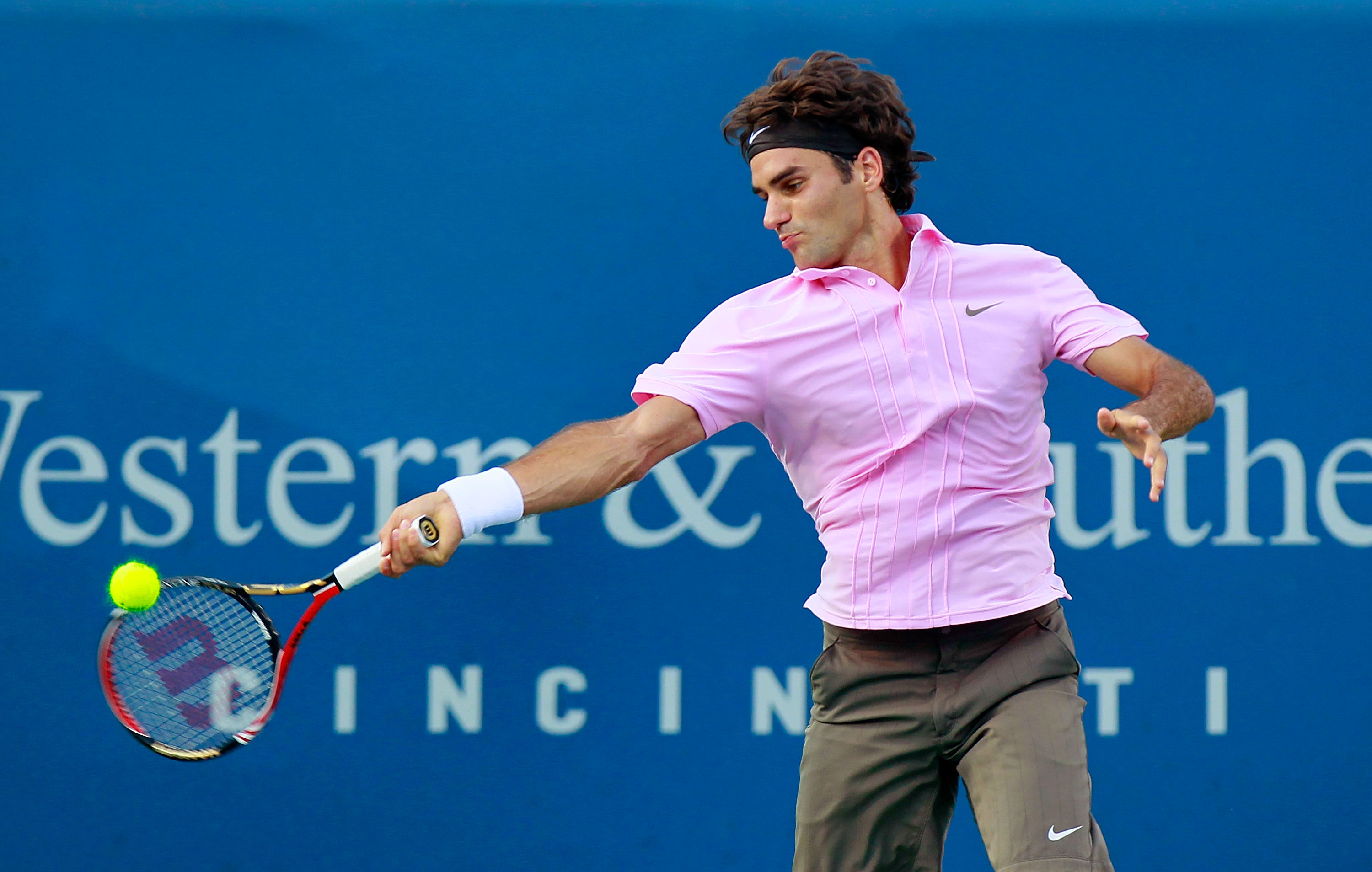CINCINNATI - AUGUST 20:  Roger Federer of Switzerland returns a forehand to Nikolay Davydenko of Russia during Day 5 of the Western & Southern Financial Group Masters at the Lindner Family Tennis Center on August 20, 2010 in Cincinnati, Ohio.  (Photo by K