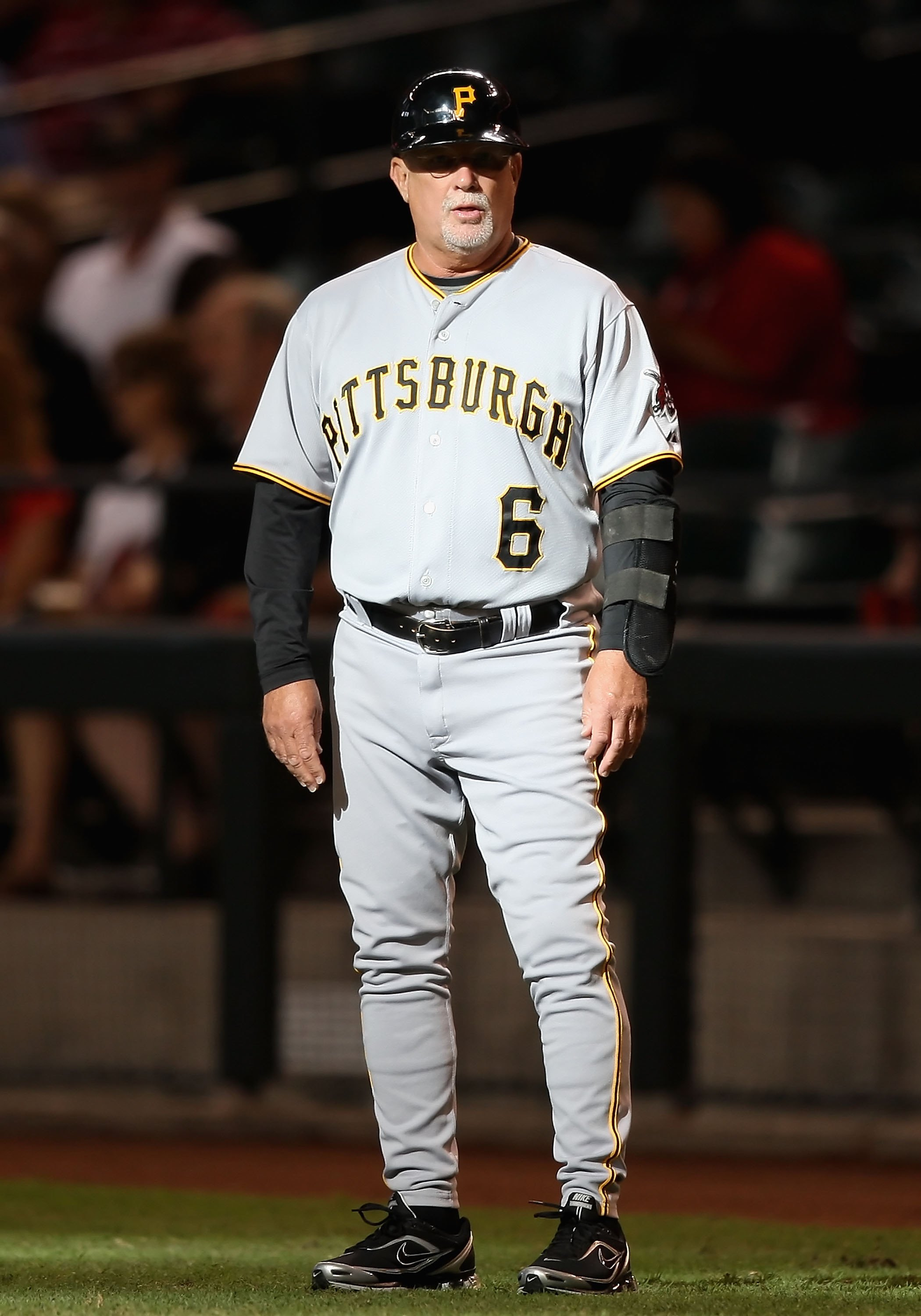 PHOENIX - JULY 25:  First base coach Perry Hill #6 of the Pittsburgh Pirates during the major league baseball game against the Arizona Diamondbacks at Chase Field on July 25, 2009 in Phoenix, Arizona. The Diamondbacks defeated the Pirates 7-0.  (Photo by