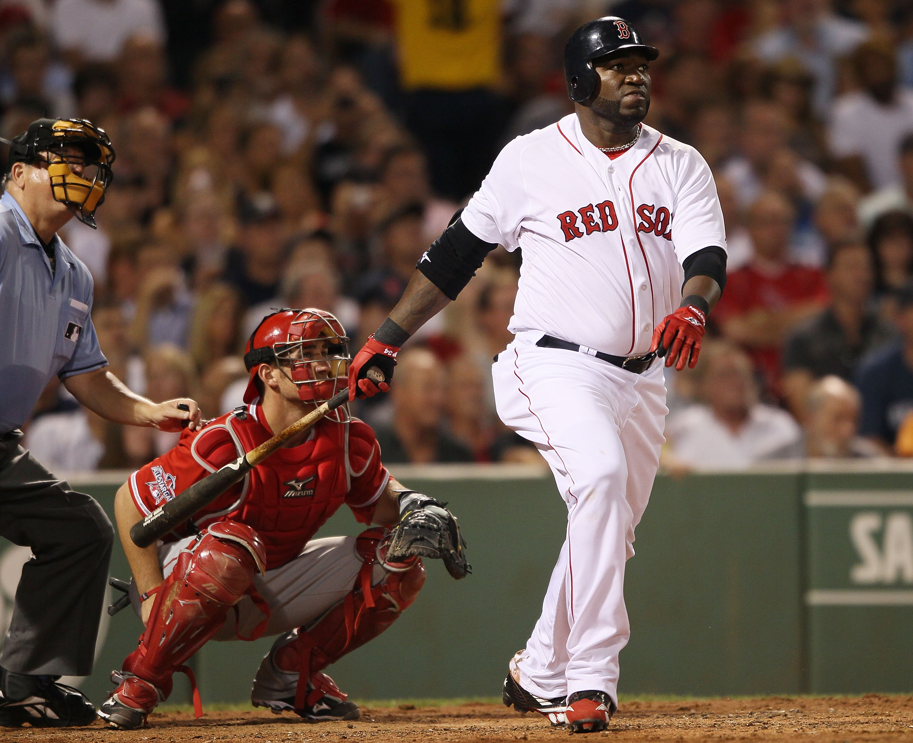 BOSTON - AUGUST 19:  David Ortiz #34  of the Boston Red Sox hits a solo home run in the fourth inning as Jeff Mathis #5 of the Los Angeles Angels of Anaheim defends on August 19, 2010 at Fenway Park in Boston, Massachusetts.  (Photo by Elsa/Getty Images)
