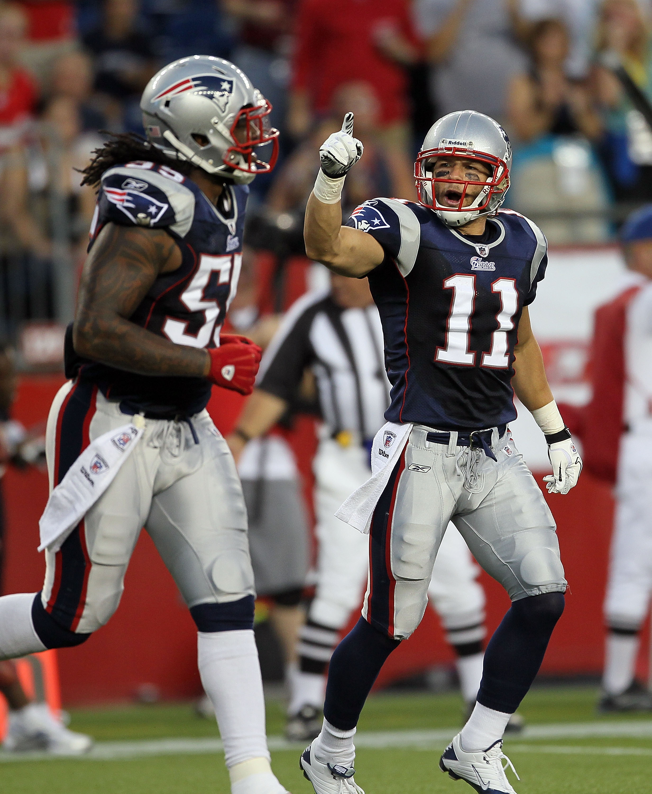 FOXBORO, MA - AUGUST 12: Brandon Spikes #55 and Julian Edelman #11 of the New England Patriots react in the first quarter during the preseason game against the New Orleans Saints at Gillette Stadium on August 12, 2010 in Foxboro, Massachusetts. (Photo by
