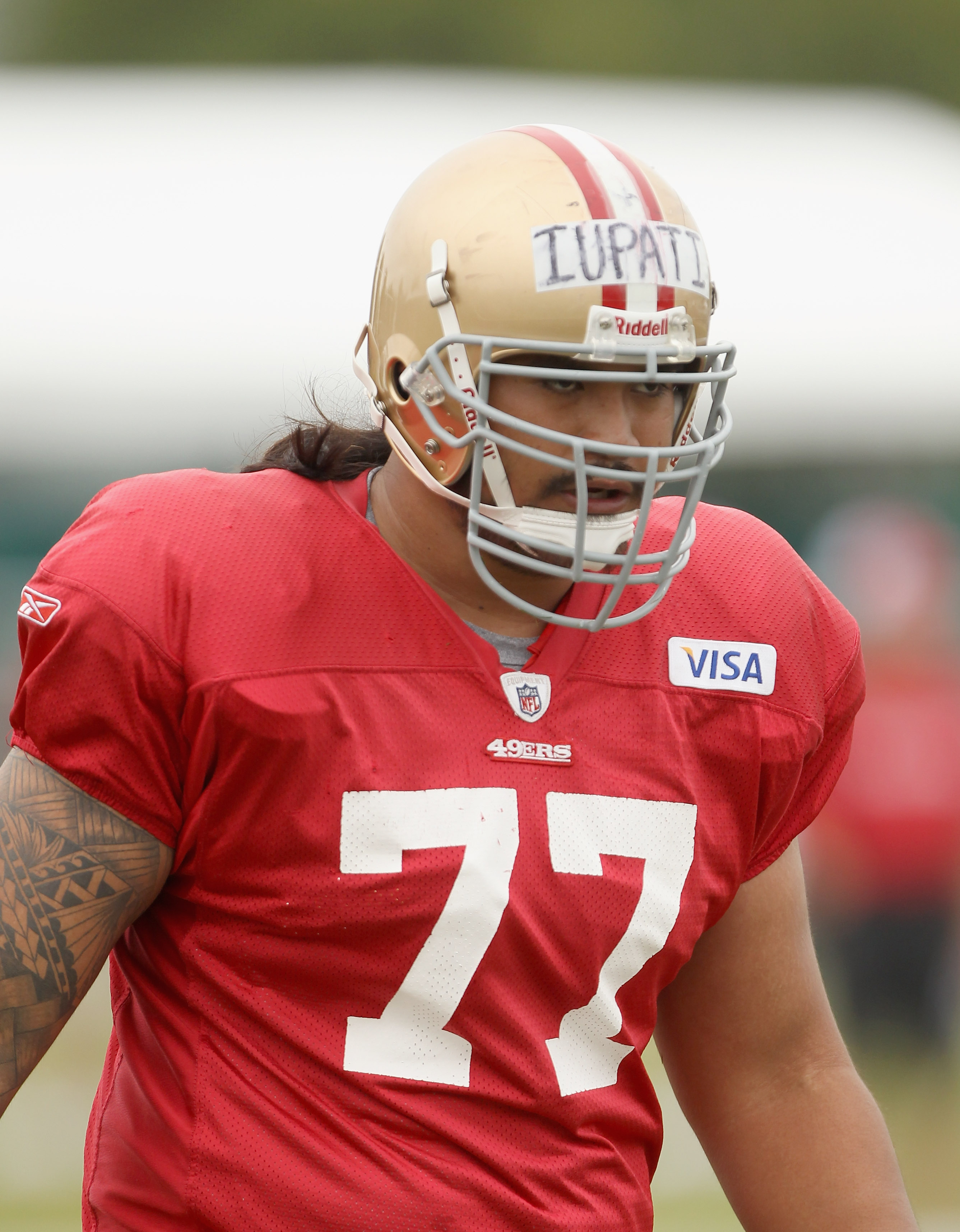 SANTA CLARA, CA - AUGUST 02:  Mike Iupati #77 works out during the San Francisco 49ers training camp at their training complex on August 2, 2010 in Santa Clara, California.  (Photo by Ezra Shaw/Getty Images)