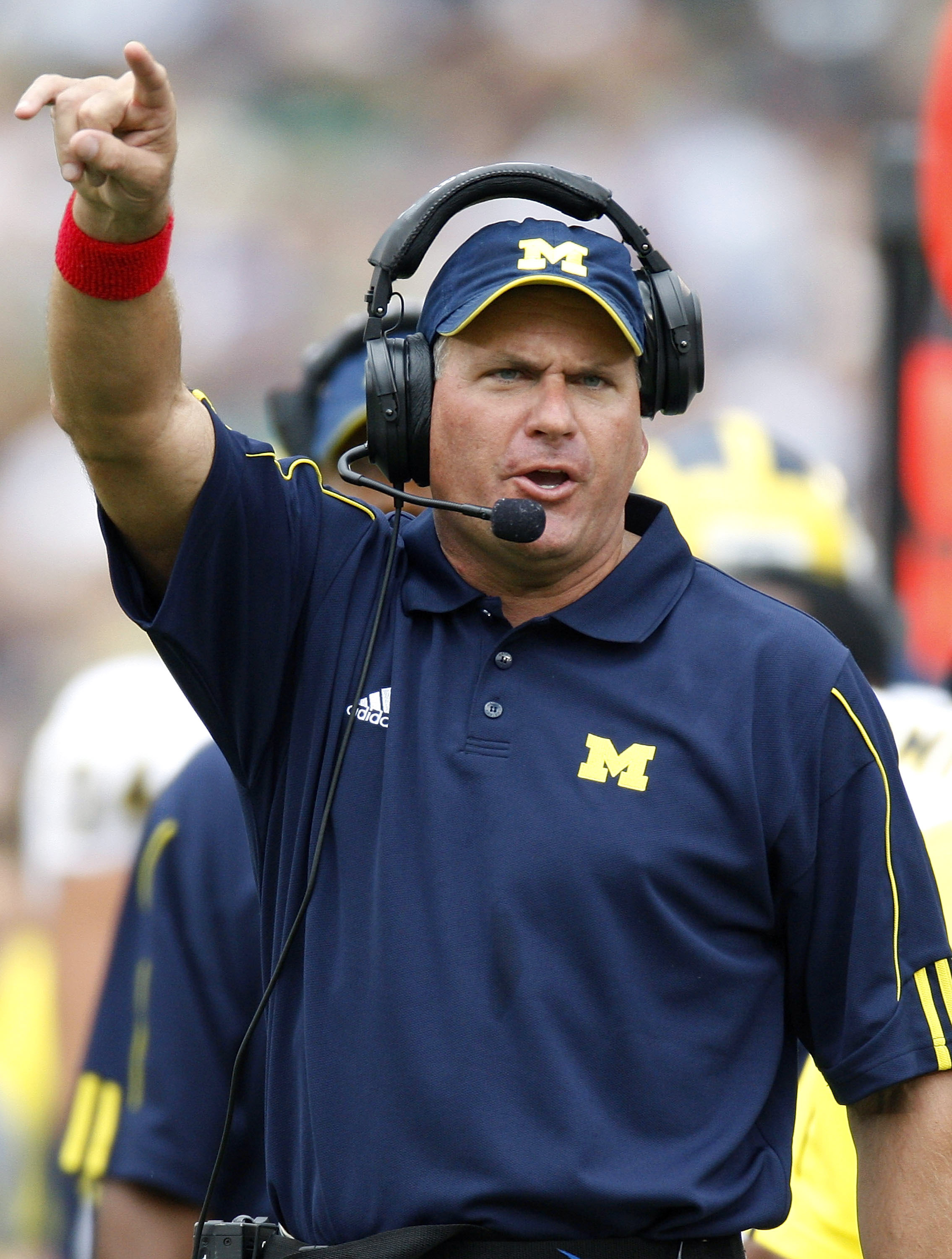SOUTH BEND, IN - SEPTEMBER 13: Head coach Rich Rodriguez of the Michigan Wolverines yells from the sideline in the first quarter while playing the Notre Dame Fighting Irishon September 13, 2008 at Notre Dame Stadium in South Bend, Indiana. Notre Dame won