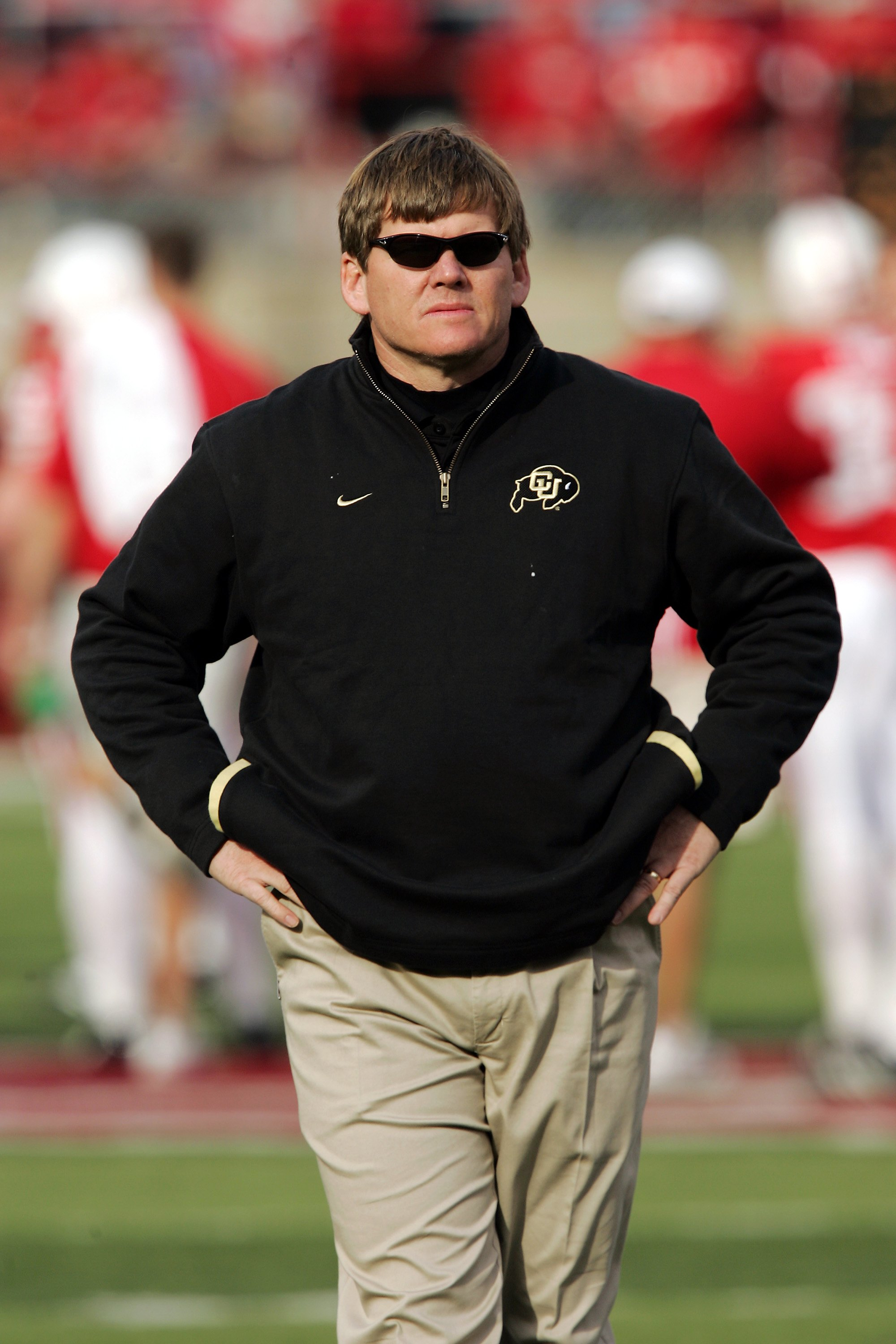 LINCOLN, NE - NOVEMBER 24:  Head coach Dan Hawkins of the Colorado Buffaloes watches his team warm up before a game against the Nebraska Cornhuskers on November 24, 2006 at Memorial Stadium in Lincoln, Nebraska.  Nebraska won 37-14.  (Photo by Brian Bahr/
