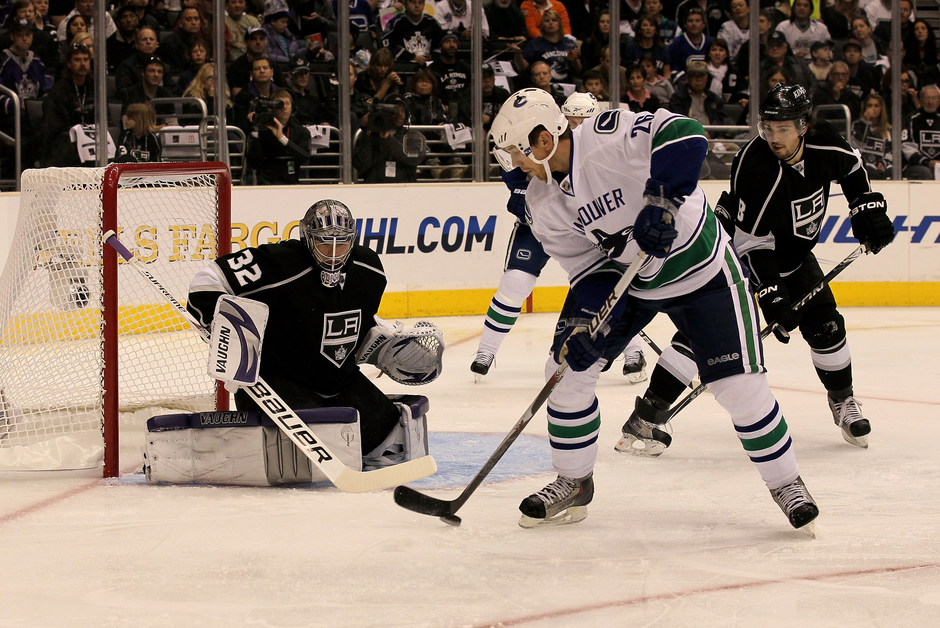 LOS ANGELES - APRIL 25:  Mikael Samuelsson #26 of the Vancouver Canucks handles the puck in front of goaltender Jonathan Quick #32 of the Los Angeles Kings during Game Six of the Western Conference Quarterfinals of the 2010 NHL Stanley Cup Playoffs on Apr