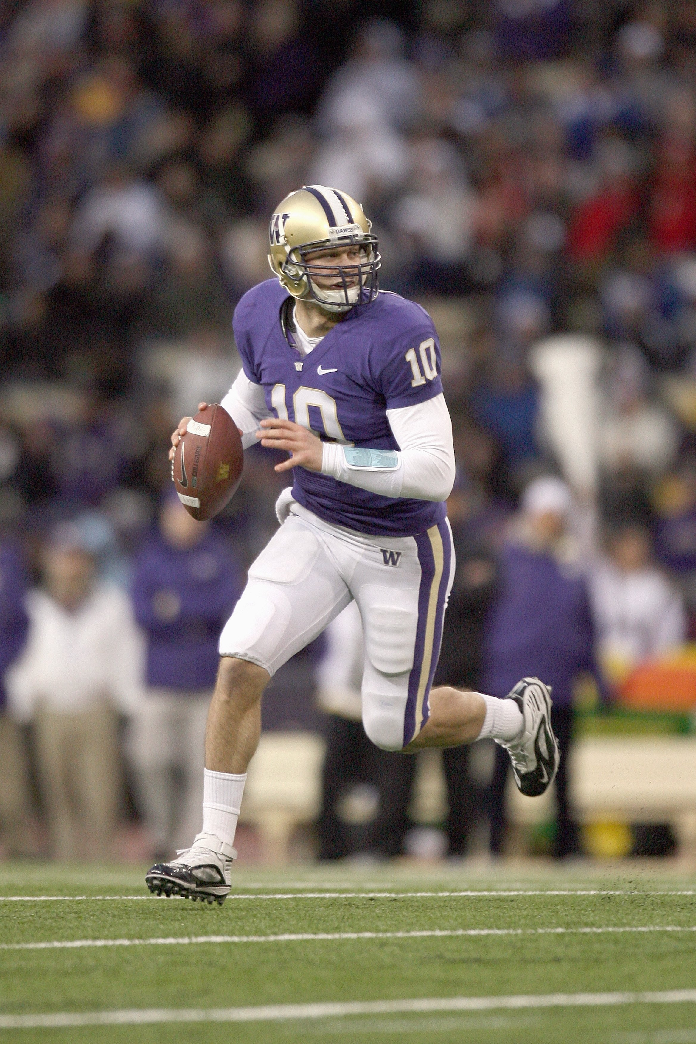 SEATTLE - DECEMBER 05: Quarterback Jake Locker #10 of the Washington Huskies moves to pass the ball during game against the California Bears on December 5, 2009 at Husky Stadium in Seattle, Washington. The Huskies defeated the Bears 42-10. (Photo by Otto