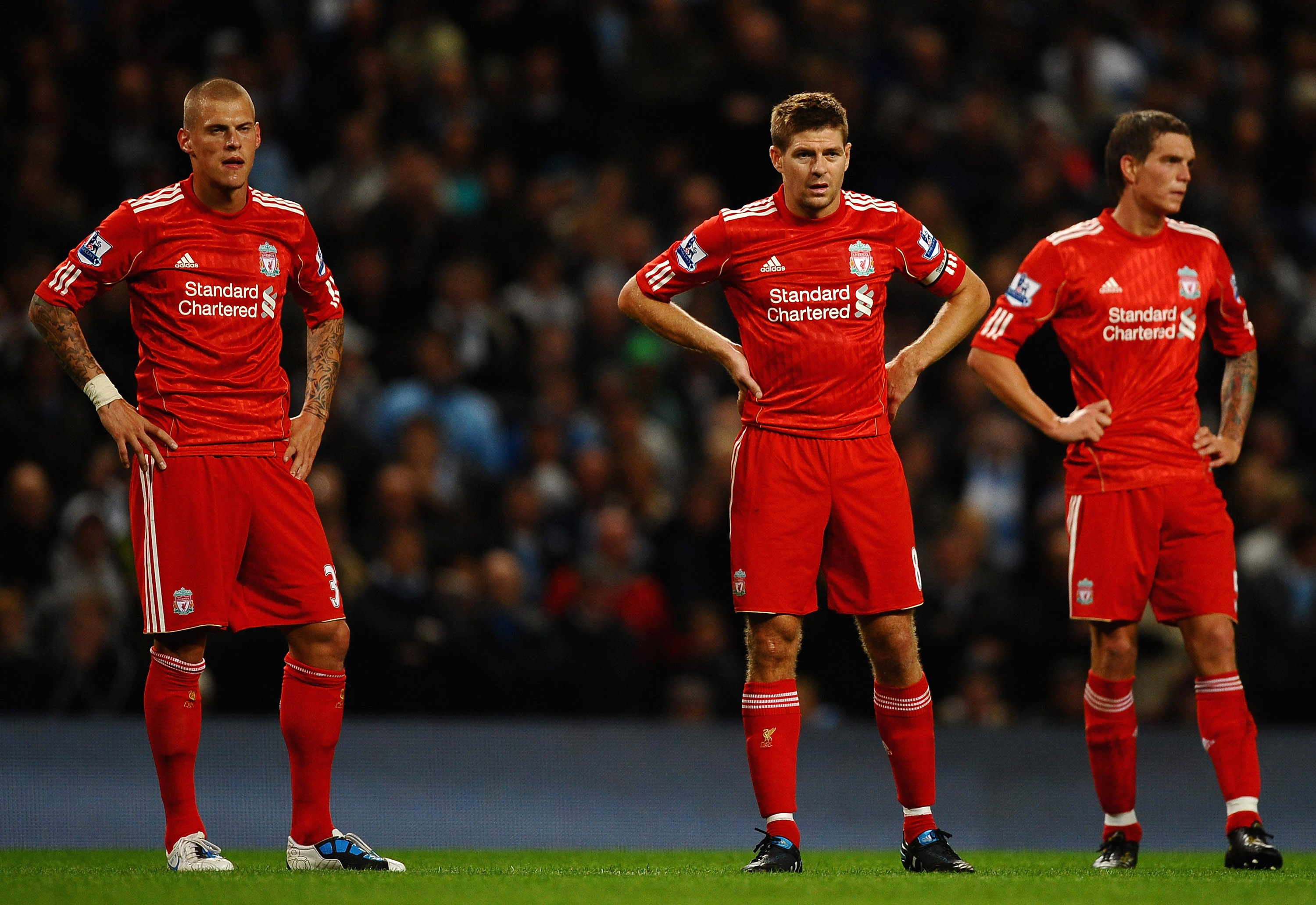 Baffled Reds' Players Delve Look Distraught after City Hammering
