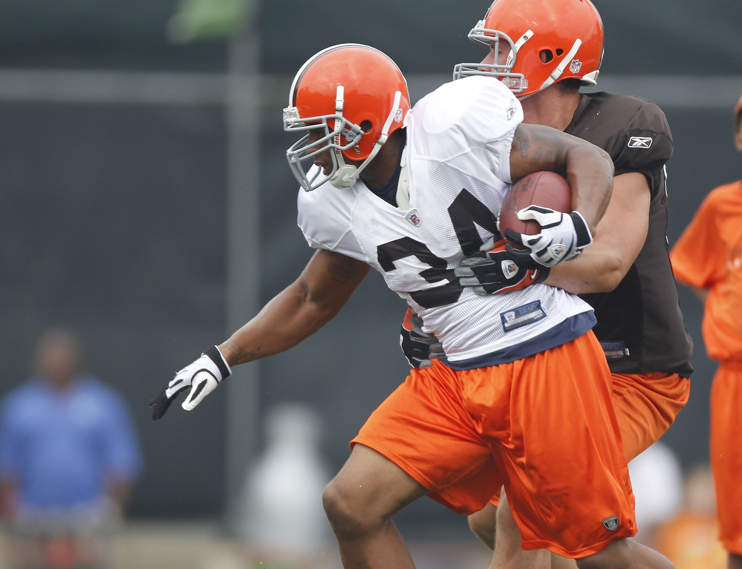 BEREA, OH - AUGUST 04:  Chris Jennings #34 of the Cleveland Browns tries to escape a tackle during training camp at the Cleveland Browns Training and Administrative Complex on August 4, 2010 in Berea, Ohio.  (Photo by Gregory Shamus/Getty Images)