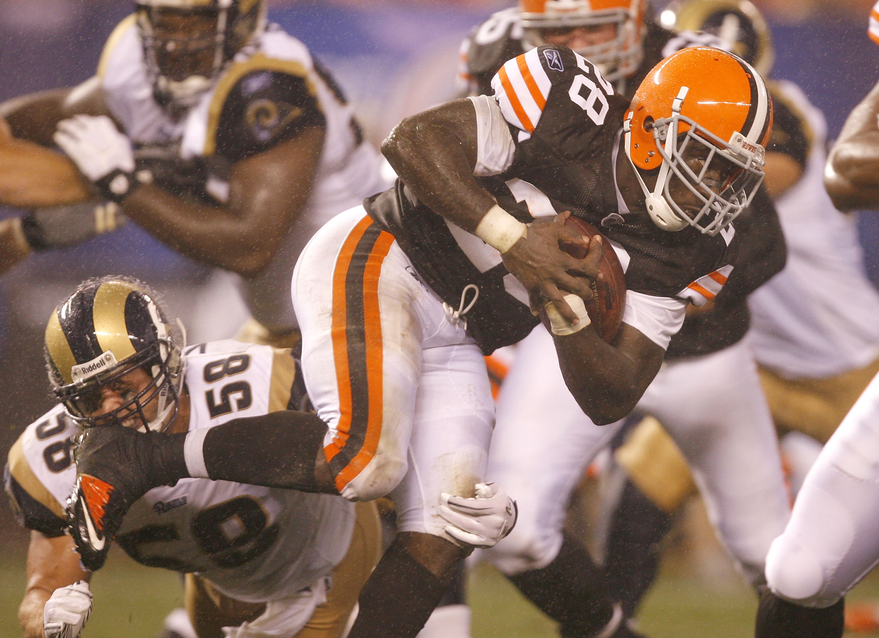 CLEVELAND - AUGUST 21:  James Davis #28 of the Cleveland Browns runs by David Vobora #58 of the St. Louis Rams at Cleveland Browns Stadium on August 21, 2010 in Cleveland, Ohio.  (Photo by Matt Sullivan/Getty Images)